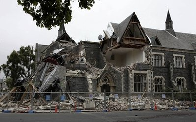 A building in Christchurch, New Zealand, is destroyed after an earthquake struck Tuesday, Feb. 22, 2011. The 6.3-magnitude quake collapsed buildings and is sending rescuers scrambling to help trapped people amid reports of multiple deaths. (AP Photo/NZPA, Pam Johnson) NEW ZEALAND OUT, NO ARCHIVES, NO SALES