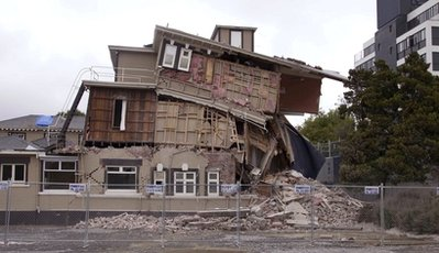 A collapsed building is barricaded following an earthquake in Christchurch, New Zealand, Tuesday, Feb. 22, 2011. A powerful earthquake collapsed buildings at the height of a busy workday Tuesday, killing and trapping dozens in one of the country's worst natural disasters. (AP Photo/New Zealand Herald) NEW ZEALAND OUT, AUSTRALIA OUT