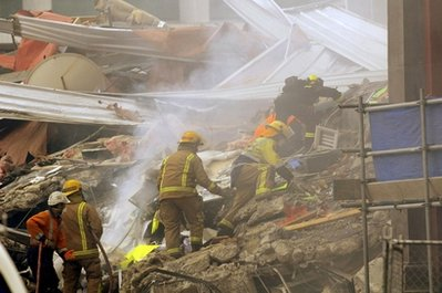 Rescue workers sift through the debris of a collapsed building after an earthquake rocked Christchurch, New Zealand, Tuesday, Feb. 22, 2011. The 6.3-magnitude quake hit at the height of a busy workday Tuesday, toppling tall buildings and churches, crushing buses and killing dozens of people in one of the country's worst natural disasters. (AP Photo/NZPA, David Wethey) NEW ZEALAND OUT, NO ARCHIVES, NO SALES