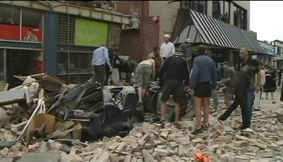 In this image made from video run by New Zealand's TVNZ,  people stand in the rubble of collapsed building following a strong earthquake  in Christchurch, New Zealand Tuesday, Feb. 22, 2011. The 6.3-magnitude earthquake rocked the southern New Zealand city of Christchurch on Tuesday, seriously injuring people and damaging buildings throughout the city. (AP Photo/TVNZ via Associated Press Television News) NEW ZEALAND OUT, TV OUT