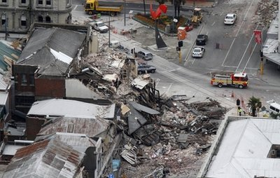 Rescue workers block off a collapsed building in central Christchurch, New Zealand, Tuesday, Feb. 22, 2011. A powerful earthquake collapsed buildings at the height of a busy workday killing at least 65 people and trapping dozens in one of the country's worst natural disasters. (AP Photo/New Zealand Herald, Mark Mitchell) NEW ZEALAND OUT, AUSTRALIA OUT