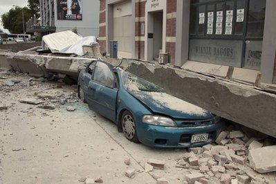 A car is crushed by a beam in central Christchurch, New Zealand, Tuesday, Feb. 22, 2011. A powerful earthquake collapsed buildings at the height of a busy workday killing and trapping dozens in one of the country's worst natural disasters. (AP Photo/New Zealand Herald, Mark Mitchell) NEW ZEALAND OUT, AUSTRALIA OUT