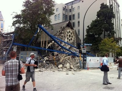 People look at a damaged church after a powerful earthquake struck Christchurch, New Zealand, Tuesday, Feb, 22, 2011. The 6.3-magnitude quake collapsed buildings and is sending rescuers scrambling to help trapped people amid reports of multiple deaths. (AP Photo/Layton Duncan)