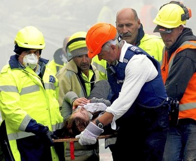 An injured person is carried by rescue workers after an earthquake rocked Christchurch, New Zealand, Tuesday, Feb. 22, 2011. The 6.3-magnitude quake hit at the height of a busy workday Tuesday, toppling tall buildings and churches, crushing buses and killing dozens of people in one of the country's worst natural disasters. (AP Photo/NZPA, David Wethey) NEW ZEALAND OUT, NO ARCHIVES, NO SALES