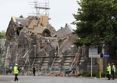 Emergency workers clock off a damaged building in Christchurch, New Zealand, Tuesday, Feb. 22, 2011. A powerful earthquake collapsed buildings at the height of a busy workday killing and trapping dozens of people in one of the country's worst natural disasters. (AP Photo/NZPA/Ashburton Guardian, Kirsty Graham) NEW ZEALAND OUT, NO ARCHIVES, NO SALES