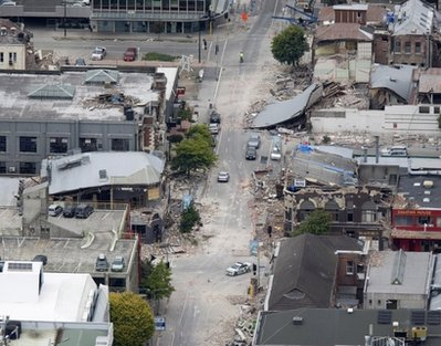 Debris litter central Christchurch, New Zealand, following an earthquake Tuesday, Feb. 22, 2011. A powerful earthquake collapsed buildings at the height of a busy workday killing at least 65 people and trapping dozens in one of the country's worst natural disasters. (AP Photo/New Zealand Herald, Mark Mitchell) NEW ZEALAND OUT, AUSTRALIA OUT