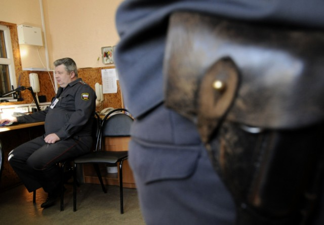 A photo taken through a gap between two computer monitors shows a police officer on duty speaking by phone in a police station in the ancient Russian city of Veliky Novgorod, some 520 km northwest of Moscow, on March 1, 2011. The Law on Police, recently signed by President Dmitry Medvedev, takes effect on March 1 and includes, among other things, that the current name ?militia? will be replaced by ?police?, and it will entail considerable financial expenditure. The Interior Ministry, however, has not yet decided how much funding it will spend on new uniform and the replacement of certificates, signboards and stickers on cars.   AFP PHOTO / MIKHAIL MORDASOV , A police officer on duty sits in a police station in the ancient Russian city of Veliky Novgorod, some 520 km northwest of Moscow, on March 1, 2011. The Law on Police, recently signed by President Dmitry Medvedev, takes effect on March 1. It includes, among other things, that the current name ?militia? will be replaced by ?police?, and it will entail considerable financial expenditure. The Interior Ministry, however, has not yet decided how much funding it will spend on new uniform and the replacement of certificates, signboards and stickers on cars.   AFP PHOTO / MIKHAIL MORDASOV