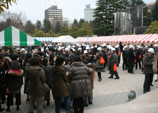People evacuating gather at a park after a massive earthquake off the coast of Japan at Sendai city in Fukushima prefecture on March 11, 2011.  massive 8.9-magnitude earthquake hit Japan on March 11, unleashing a monster 10-metre high tsunami that sent ships crashing into the shore and carried cars through the streets of coastal towns. AFP PHOTO / JIJI PRESS