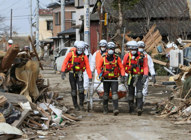 Rescue team members carry a dead body at Ofunato city in Iwate city on March 14, 2011. A new explosion at a nuclear plant hit punch-drunk Japan on March 14 as it raced to avert a reactor meltdown after a quake-tsunami disaster that is feared to have killed more than 10,000 people.   AFP PHOTO / JIJI PRESS , A masked boy walks past nearly empty shelves at a supermarket in the northwestern city of Akita on March 15, 2011 as panic buying sweeps the country following the March 11 earthquake and tsunami in eastern Japan as well as a nuclear crisis in Fukushima prefecture. Japan's nuclear crisis escalated on March 15 as two more blasts and a fire rocked the quake-stricken atomic power plant, sending radiation up to dangerous levels.    AFP PHOTO / ROSLAN RAHMAN , A supermarket staff member displays a notice informing customers of purchases of goods will be limited at a supermarket in the northwestern city of Akita on March 15, 2011 as panic buying sweeps the country following the March 11 earthquake and tsunami in eastern Japan as well as a nuclear crisis in Fukushima prefecture. Japan's nuclear crisis escalated on March 15 as two more blasts and a fire rocked the quake-stricken atomic power plant, sending radiation up to dangerous levels.    AFP PHOTO / ROSLAN RAHMAN , In a picture taken on March 14, 2011 a man (L) cries as he walks through the devastation at Onagawa town in Miyagi prefecture caused by the March 11 earthquake and tsunami. Japan is struggling to cope with the enormity of the damage from the record-breaking quake and the tsunami which raced across vast tracts of its northeast, destroying all before it. The official death toll has risen to 2,414, police said on March 15, but officials say at least 10,000 are likely to have perished. JAPAN OUT  RESTRICTED TO EDITORIAL USE  AFP PHOTO / YOMIURI SHIMBUN , In a picture taken on March 14, 2011 a man (C) sleeps on a chair at an evacuation shelter at Otsuchi town in Iwate prefecture following the March 11 earthquake and tsunami. Japan is struggling to cope with the enormity of the damage from the record-breaking quake and the tsunami which raced across vast tracts of its northeast, destroying all before it. The official death toll has risen to 2,414, police said on March 15, but officials say at least 10,000 are likely to have perished.  JAPAN OUT  RESTRICTED TO EDITORIAL USE  AFP PHOTO / YOMIURI SHIMBUN , In a picture taken on March 14, 2011 two women cover their mouths against the threat of radiation at Yamada town in Iwate prefecture. Radiation levels near a quake-hit nuclear plant are now harmful to human health, Japan's government said after two explosions and a fire at the crippled facility on March 15. A higher than normal level of radiation was detected in Tokyo, but a city official said it was not considered at a level harmful to human health. JAPAN OUT  RESTRICTED TO EDITORIAL USE  AFP PHOTO / YOMIURI SHIMBUN , A woman walks past a near empty showcase of drinks and instant foods at a convenience store following panic buying after the March 11 earthquake and tsunami, in Tokyo on March 15, 2011.  A higher than normal level of radiation was detected in Japan's capital Tokyo, but a city government official said it was not considered at the level where it harms human health.   AFP PHOTO / Yoshikazu TSUNO , A man looks at a near empty showcase of drinks and instant foods at a convenience store following panic buying after the March 11 earthquake and tsunami, in Tokyo on March 15, 2011.  A higher than normal level of radiation was detected in Japan's capital Tokyo, but a city government official said it was not considered at the level where it harms human health.   AFP PHOTO / Yoshikazu TSUNO , Japanese Self-Defense Force soldiers carry the body of a tsunami victim in the city of Ofunato, Iwate prefecture on March 15, 2011 as the country struggles to cope following the March 11 earthquake and tsunami disasters. Japan's government on March 15 urged people against panic-buying of food and supplies, as the country grapples with a massive natural disaster and resulting nuclear crisis.    AFP PHOTO / TOSHIFUMI KITAMURA , Japanese Self-Defense Force soldiers walk past destroyed buildings in the city of Ofunato, Iwate prefecture on March 15, 2011 as the country struggles to cope following the March 11 earthquake and tsunami disasters. Japan's government on March 15 urged people against panic-buying of food and supplies, as the country grapples with a massive natural disaster and resulting nuclear crisis.    AFP PHOTO / TOSHIFUMI KITAMURA , Japanese rescue team members transport a body in the town of Watari in Miyagi prefecture on March 14, 2011 three days after a massive 8.9 magnitude earthquake and tsunami devastated the coast of eastern Japan. A new explosion at a nuclear plant in nearby Fukushima prefecture hit punch-drunk Japan on March 14 as it raced to avert a reactor meltdown after a quake-tsunami disaster that is feared to have killed more than 10,000 people.    AFP PHOTO / JIJI PRESS