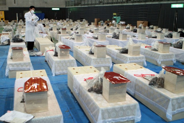Evacuees eat instant noodles for lunch at a shelter in Rikuzentakata in Iwate prefecture on March 18, 2011, one week after a massive earthquake and tsunami ravaged northeastern Japan. Japan battled a nuclear and humanitarian crisis on March 18 as engineers worked to restore power to a stricken atomic plant, while the toll of dead and missing from the quake and tsunami topped 16,000. AFP PHOTO / KAZUHIRO NOGI , Volunteers distribute rice balls during lunch at a shelter in Rikuzentakata in Iwate prefecture on March 18, 2011, one week after a massive earthquake and tsunami ravaged northeastern Japan. Japan battled a nuclear and humanitarian crisis on March 18 as engineers worked to restore power to a stricken atomic plant, while the toll of dead and missing from the quake and tsunami topped 16,000. AFP PHOTO / KAZUHIRO NOGI , Evacuees eat instant noodles for lunch at a shelter in Rikuzentakata in Iwate prefecture on March 18, 2011, one week after a massive earthquake and tsunami ravaged northeastern Japan. Japan battled a nuclear and humanitarian crisis on March 18 as engineers worked to restore power to a stricken atomic plant, while the toll of dead and missing from the quake and tsunami topped 16,000. AFP PHOTO / KAZUHIRO NOGI , Nurses take care of a patient who was evacuated from a nursing home in Tomioka town, 60 km from the nuclear power plant in Fukushima prefecture, in Koriyama on March 18, 2011. Japan battled a nuclear and humanitarian crisis as engineers worked to restore power to a stricken atomic plant, while the toll of dead and missing from the quake and tsunami topped 16,000.  AFP PHOTO / Ken SHIMIZU , Nurses take care of a patient who was evacuated from a nursing home in Tomioka town, 60 km from the nuclear power plant in Fukushima prefecture, in Koriyama on March 18, 2011. Japan battled a nuclear and humanitarian crisis as engineers worked to restore power to a stricken atomic plant, while the toll of dead and missing from the quake and tsunami topped 16,000.  AFP PHOTO / Ken SHIMIZU , Nurses take care of a patient who was evacuated from a nursing home in Tomioka town, 60 km from the nuclear power plant in Fukushima prefecture, in Koriyama on March 18, 2011. Japan battled a nuclear and humanitarian crisis as engineers worked to restore power to a stricken atomic plant, while the toll of dead and missing from the quake and tsunami topped 16,000.  AFP PHOTO / Ken SHIMIZU , A two-month old baby evacuated along with his parents from the town of Okuma, Fubata district in Fukushima prefecture where the TEPCO Fukushima Daiichi nuclear power plant, is given a bath by a volunteer, Junko Sakamoto in Koriyama city in Fukushima prefecture on March 18, 2011. Japan conducted new water cooling operations at a quake-hit nuclear plant, using a fleet of fire trucks as workers racing to avert a catastrophe also ran a power cable to the site.  AFP PHOTO / Go TAKAYAMA , A family evacuated from Tomioka town, located within 10km of the Fukushima Daiichi nuclear power plant, takes a bath for the first time since a massive earthquake and tsunami in the Total Health Clinic in Koriyama city in Fukushima prefecture on March 18, 2011. Japan battled a nuclear and humanitarian crisis on March 18 as engineers worked to restore power to a stricken atomic plant, while the toll of dead and missing from the quake and tsunami topped 16,000. AFP PHOTO / Go TAKAYAMA , A two-month old baby evacuated along with his parents from the town of Okuma, Fubata district in Fukushima prefecture where the TEPCO Fukushima Daiichi nuclear power plant, is given a bath by a volunteer, Junko Sakamoto in Koriyama city in Fukushima prefecture on March 18, 2011. Japan conducted new water cooling operations at a quake-hit nuclear plant, using a fleet of fire trucks as workers racing to avert a catastrophe also ran a power cable to the site.  AFP PHOTO / Go TAKAYAMA , A family clean out their house in the tsunami-devastated town of Otsuchi on March 18, 2011. Japan battled a nuclear and humanitarian crisis Friday as engineers worked to restore power to a stricken atomic plant, while the toll of dead and missing from the quake and tsunami topped 16,000.         AFP PHOTO / Nicholas KAMM , A family clean out their house in the tsunami-devastated town of Otsuchi on March 18, 2011. Japan battled a nuclear and humanitarian crisis Friday as engineers worked to restore power to a stricken atomic plant, while the toll of dead and missing from the quake and tsunami topped 16,000.         AFP PHOTO / Nicholas KAMM , A man cleans out his house in the tsunami-devastated town of Otsuchi on March 18, 2011. Japan battled a nuclear and humanitarian crisis Friday as engineers worked to restore power to a stricken atomic plant, while the toll of dead and missing from the quake and tsunami topped 16,000.         AFP PHOTO / Nicholas KAMM , A survivor queues for drinking water in Kesennuma in Miyagi prefecture on March 18, 2011 one week after a massive earthquake and tsunami devastated northeastern Japan.  Japan battled a nuclear and humanitarian crisis on March 18 as engineers worked to restore power to a stricken atomic plant, while the toll of dead and missing from the quake and tsunami topped 16,000.  AFP PHOTO / PHILIPPE LOPEZ , A man receives a medical check at a shelter in Rikuzentakata, Iwate prefecture on March 18, 2011, one week after the earthquake and tsunami disasters hit. Japan battled a nuclear and humanitarian crisis on March 18 as engineers worked to restore power to a stricken atomic plant, while the toll of dead and missing from the quake and tsunami topped 16,000.  AFP PHOTO / KAZUHIRO NOGI , A doctor sits apparently tired at a shelter in Rikuzentakata, Iwate prefecture on March 18, 2011, one week after the earthquake and tsunami disasters hit. Japan battled a nuclear and humanitarian crisis on March 18 as engineers worked to restore power to a stricken atomic plant, while the toll of dead and missing from the quake and tsunami topped 16,000.  AFP PHOTO / KAZUHIRO NOGI , Japanese rescuers move the body of a victim of the March 11 tsunami and earthquake found in a collapsed house in the city of Kesennuma in Miyagi prefecture on March 18, 2011. Japan battled a nuclear and humanitarian crisis on March 18 as engineers worked to restore power to a stricken atomic plant, while the toll of dead and missing from the quake and tsunami topped 16,000.   AFP PHOTO / KIM JAE-HWAN , Dozens of coffins are pictured on the floor of a hall in the town of Rifu in Miyagi prefecture on March 18, 2011 to help with the March 11 tsunami and earthquake victims. The official number of dead and missing after the devastating earthquake and tsunami that flattened Japan's northeast coast a week ago has topped 16,600, with 6,405 confirmed dead on March 18.  AFP PHOTO / JIJI PRESS