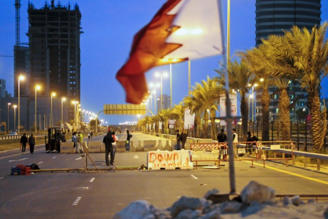 Bahraini anti-government protesters place concrete roadblocks on the highway leading to Pearl Square in Manama on March 14, 2011. Armoured troops rolled into Bahrain from neighbouring Saudi Arabia to help restore order in the strategic Gulf kingdom, where pro-democracy demonstrators have shut down the financial centre. AFP PHOTO/JAMES LAWLER DUGGAN