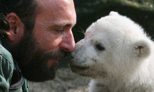 (FILES) - Picture taken on March 23, 2007 Knut, playing with his minder Thomas Doerflein during his first outing a three-month-old polar bear cub, during his first outing at Berlin's Zoologischer Garten zoo. Knut has died on March 19, 2011 according to the zoo. The cause of death was not immediately known.AFP PHOTO JOHN MACDOUGALL