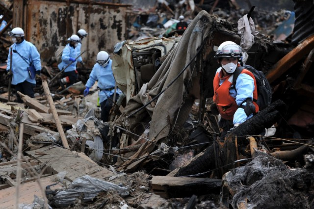 Japanese firemen from the Kyoto City department recover the body of a victim from the wreckage in Minamisanriku, Myagi province, on March 21, 2011, 10 days after a massive earthquake and tsunami ravaged northeastern Japan. The natural disaster -- Japan's deadliest since 1923 -- has left 8,649 people dead and 13,262 missing, after entire communities were swept away by the horrific tsunami or levelled by the record 9.0-magnitude quake.  Miyagi prefecture was worst hit by the quake and tsunami, with a confirmed death toll of 4,882 so far.  AFP PHOTO / PHILIPPE LOPEZ , Japanese firemen search through debris for bodies in Minamisanriku, Myagi province, on March 21, 2011, 10 days after a massive earthquake and tsunami ravaged northeastern Japan. The natural disaster -- Japan's deadliest since 1923 -- has left 8,649 people dead and 13,262 missing, after entire communities were swept away by the horrific tsunami or levelled by the record 9.0-magnitude quake.  Miyagi prefecture was worst hit by the quake and tsunami, with a confirmed death toll of 4,882 so far.  AFP PHOTO / PHILIPPE LOPEZ