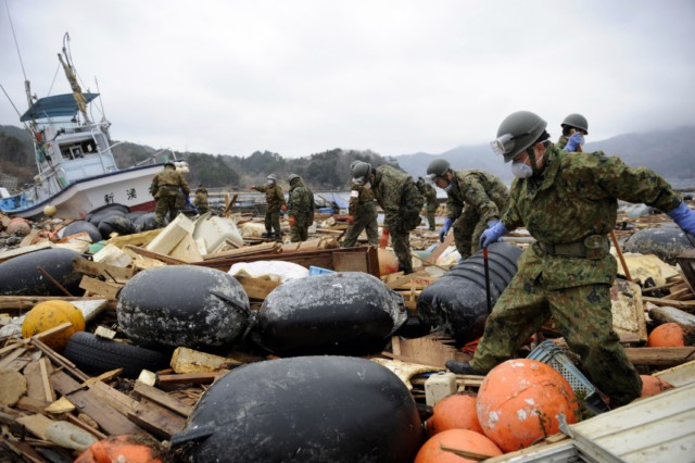 Japanese firemen from the Kyoto City department recover the body of a victim from the wreckage in Minamisanriku, Myagi province, on March 21, 2011, 10 days after a massive earthquake and tsunami ravaged northeastern Japan. The natural disaster -- Japan's deadliest since 1923 -- has left 8,649 people dead and 13,262 missing, after entire communities were swept away by the horrific tsunami or levelled by the record 9.0-magnitude quake.  Miyagi prefecture was worst hit by the quake and tsunami, with a confirmed death toll of 4,882 so far.  AFP PHOTO / PHILIPPE LOPEZ , Japanese firemen search through debris for bodies in Minamisanriku, Myagi province, on March 21, 2011, 10 days after a massive earthquake and tsunami ravaged northeastern Japan. The natural disaster -- Japan's deadliest since 1923 -- has left 8,649 people dead and 13,262 missing, after entire communities were swept away by the horrific tsunami or levelled by the record 9.0-magnitude quake.  Miyagi prefecture was worst hit by the quake and tsunami, with a confirmed death toll of 4,882 so far.  AFP PHOTO / PHILIPPE LOPEZ , A picture shows the rubble and debris 10 days after the massive 9.0 earthquake and tsunami hit the island of Oshima in Miyagi prefecture on March 21, 2011. The March 11 natural disaster -- Japan's deadliest since 1923 -- has left 8,649 people dead and 13,262 missing, after entire communities were swept away by the horrific tsunami or levelled by the record quake.  AFP PHOTO/ Nicolas ASFOURI , A Japanese man stands looking at his destroyed house 10 days after the massive 9.0 earthquake and tsunami hit the island of Oshima in Miyagi prefecture on March 21, 2011. The March 11 natural disaster -- Japan's deadliest since 1923 -- has left 8,649 people dead and 13,262 missing, after entire communities were swept away by the horrific tsunami or levelled by the record quake.  AFP PHOTO/ Nicolas ASFOURI , People walk beside a damaged yacht that was washed up onto a bridge 10 days after the massive 9.0 earthquake and tsunami in Ishinomaki, Miyagi prefecture, on March 21, 2011.  The March 11 natural disaster -- Japan's deadliest since 1923 -- has left 8,649 people dead and 13,262 missing, after entire communities were swept away by the horrific tsunami or levelled by the record quake.    AFP PHOTO/Toru YAMANAKA , A picture shows a boat sticking out of a building 10 days after the massive 9.0 earthquake and tsunami in Ishinomaki, Miyagi prefecture, on March 21, 2011.  The March 11 natural disaster -- Japan's deadliest since 1923 -- has left 8,649 people dead and 13,262 missing, after entire communities were swept away by the horrific tsunami or levelled by the record quake.    AFP PHOTO/Toru YAMANAKA , Cars shifted by the tsunami lie in a swimming pool 10 days after the massive 9.0 earthquake and tsunami in Ishinomaki, Miyagi prefecture, on March 21, 2011.  The March 11 natural disaster -- Japan's deadliest since 1923 -- has left 8,649 people dead and 13,262 missing, after entire communities were swept away by the horrific tsunami or levelled by the record quake.    AFP PHOTO/Toru YAMANAKA , A man walks with his bicycle in front of a destroyed yacht that was washed up onto a bridge 10 days after the massive 9.0 earthquake and tsunami in Ishinomaki, Miyagi prefecture, on March 21, 2011.  The March 11 natural disaster -- Japan's deadliest since 1923 -- has left 8,649 people dead and 13,262 missing, after entire communities were swept away by the horrific tsunami or levelled by the record quake.    AFP PHOTO/Toru YAMANAKA , A woman looks out at the devastation 10 days after the massive 9.0 earthquake and tsunami in Ishinomaki, Miyagi prefecture, on March 21, 2011.  The March 11 natural disaster -- Japan's deadliest since 1923 -- has left 8,649 people dead and 13,262 missing, after entire communities were swept away by the horrific tsunami or levelled by the record 9.0-magnitude quake.    AFP PHOTO/Toru YAMANAKA , A woman picks her way through piles of debris 10 days after the massive 9.0 earthquake and tsunami in Ishinomaki, Miyagi prefecture, on March 21, 2011.  The March 11 natural disaster -- Japan's deadliest since 1923 -- has left 8,649 people dead and 13,262 missing, after entire communities were swept away by the horrific tsunami or levelled by the record 9.0-magnitude quake.    AFP PHOTO/Toru YAMANAKA , A boat sits lodged into the side of a building with a car on its stern close to the port in Ishinomaki in Miyagi prefecture on March 21, 2011. Driving rain on March 21 disrupted rescue efforts in Japan and compounded the misery of disaster survivors now fearing radioactive fallout from the smouldering wreck of a nuclear plant.     AFP PHOTO / MIKE CLARKE , A woman stands in front of a grounded fishing boat and debris in Kesennuma, Miyagi prefecture, on March 21, 2011 after the March 11 tsunami and earthquake devastated northeastern Japan.  Heavy rain along the northeast coast disrupted post-tsunami rescue efforts and compounded the misery of survivors now fearing radioactive fallout from the wrecked Fukushima plant, which has suffered a series of explosions and fires. The March 11 natural disaster -- Japan's deadliest since 1923 -- has left 8,649 people dead and 13,262 missing, after entire communities were swept away by the horrific tsunami or levelled by the record 9.0-magnitude quake. AFP PHOTO / FRED DUFOUR , A picture shows beached fishing boats and debris in Kesennuma, Miyagi prefecture, on March 21, 2011 after the March 11 tsunami and earthquake devastated northeastern Japan.  Heavy rain along the northeast coast disrupted post-tsunami rescue efforts and compounded the misery of survivors now fearing radioactive fallout from the wrecked Fukushima plant, which has suffered a series of explosions and fires. The March 11 natural disaster -- Japan's deadliest since 1923 -- has left 8,649 people dead and 13,262 missing, after entire communities were swept away by the horrific tsunami or levelled by the record 9.0-magnitude quake.  AFP PHOTO/KAZUHIRO NOGI , A general view shows tsunami damage from the March 11 tsunami and earthquake on the island of Oshima in Miyagi prefecture on March 21, 2011. Japan has ordered a halt to shipments of certain foods from four prefectures after abnormal radiation levels were found in products near a quake-hit nuclear plant, a government spokesman said. AFP PHOTO/ Nicolas ASFOURI , A father carries his son on his shoulders as they look out over the devastation to the port city of Kesennuma in Miyagi prefecture on March 21, 2011 10 days after an earthquake and tsunami hit the northeastern coast of Japan. The number of people confirmed dead or listed as missing in Japan neared 22,000, 10 days after a massive earthquake and tsunami struck the country's northeast coast.  AFP PHOTO / JIJI PRESS , Cyclists pedal their bicycles in the water as the road is covered with seawater at Kesennuma city in Miyagi prefecture on March 21, 2011. The number of people confirmed dead or listed as missing in Japan neared 22,000, 10 days after a massive earthquake and tsunami struck the country's northeast coast.  AFP PHOTO / JIJI PRESS , A couple stands in the rubble of there their house was before the March 11 tsunami in the city of Ishinomaki in Miyagi prefecture on March 21, 2011 10 days after an earthquake and tsunami hit the northeastern coast of Japan. The number of people confirmed dead or listed as missing in Japan neared 22,000, 10 days after a massive earthquake and tsunami struck the country's northeast coast.  AFP PHOTO / JIJI PRESS , A picture shows the devastation on the island of Oshima in Miyagi prefecture on March 21, 2011, 10 days after the massive 9.0 earthquake and tsunami. The March 11 natural disaster -- Japan's deadliest since 1923 -- has left 8,649 people dead and 13,262 missing, after entire communities were swept away by the horrific tsunami or levelled by the record quake.  AFP PHOTO/ Nicolas ASFOURI , Japanese officials assess the damage on the island of Oshima in Miyagi prefecture on March 21, 2011, 10 days after the massive 9.0 earthquake and tsunami. The March 11 natural disaster -- Japan's deadliest since 1923 -- has left 8,649 people dead and 13,262 missing, after entire communities were swept away by the horrific tsunami or levelled by the record quake.  AFP PHOTO/ Nicolas ASFOURI , A resident walks amid the debris and rubble on the island of Oshima in Miyagi prefecture on March 21, 2011, 10 days after the massive 9.0 earthquake and tsunami. The March 11 natural disaster -- Japan's deadliest since 1923 -- has left 8,649 people dead and 13,262 missing, after entire communities were swept away by the horrific tsunami or levelled by the record quake.  AFP PHOTO/ Nicolas ASFOURI , Japanese officials assess the damage on the island of Oshima in Miyagi prefecture on March 21, 2011, 10 days after the massive 9.0 earthquake and tsunami. The March 11 natural disaster -- Japan's deadliest since 1923 -- has left 8,649 people dead and 13,262 missing, after entire communities were swept away by the horrific tsunami or levelled by the record quake.  AFP PHOTO/ Nicolas ASFOURI , Japanese officials assess the damage on the island of Oshima in Miyagi prefecture on March 21, 2011, 10 days after the massive 9.0 earthquake and tsunami. The March 11 natural disaster -- Japan's deadliest since 1923 -- has left 8,649 people dead and 13,262 missing, after entire communities were swept away by the horrific tsunami or levelled by the record quake.  AFP PHOTO/ Nicolas ASFOURI , Japanese officials assess the damage as they walk through the debris on the island of Oshima in Miyagi prefecture on March 21, 2011, 10 days after the massive 9.0 earthquake and tsunami. The March 11 natural disaster -- Japan's deadliest since 1923 -- has left 8,649 people dead and 13,262 missing, after entire communities were swept away by the horrific tsunami or levelled by the record quake.  AFP PHOTO/ Nicolas ASFOURI , Japanese officials assess the damage next to a large boat washed up on the island of Oshima in Miyagi prefecture on March 21, 2011, 10 days after the massive 9.0 earthquake and tsunami. The March 11 natural disaster -- Japan's deadliest since 1923 -- has left 8,649 people dead and 13,262 missing, after entire communities were swept away by the horrific tsunami or levelled by the record quake.  AFP PHOTO/ Nicolas ASFOURI , A picture shows the devastation on the island of Oshima in Miyagi prefecture on March 21, 2011, 10 days after the massive 9.0 earthquake and tsunami. The March 11 natural disaster -- Japan's deadliest since 1923 -- has left 8,649 people dead and 13,262 missing, after entire communities were swept away by the horrific tsunami or levelled by the record quake.  AFP PHOTO/ Nicolas ASFOURI , Survivors walk along a street lined with damaged houses on the island of Oshima in Miyagi prefecture on March 21, 2011, 10 days after the massive 9.0 earthquake and tsunami. The March 11 natural disaster -- Japan's deadliest since 1923 -- has left 8,649 people dead and 13,262 missing, after entire communities were swept away by the horrific tsunami or levelled by the record quake.  AFP PHOTO/ Nicolas ASFOURI , A Japanese tsunami survivor sorts through her belongings on the island of Oshima in Miyagi prefecture on March 21, 2011, 10 days after the massive 9.0 earthquake and tsunami. The March 11 natural disaster -- Japan's deadliest since 1923 -- has left 8,649 people dead and 13,262 missing, after entire communities were swept away by the horrific tsunami or levelled by the record quake.  AFP PHOTO/ Nicolas ASFOURI , A bus sits on a building, lodged there by the March 11 tsunami, in the city of Ishinomaki in Miyagi prefecture on March 21, 2011 10 days after an earthquake and tsunami hit the northeastern coast of Japan. . The number of people confirmed dead or listed as missing in Japan neared 22,000, 10 days after a massive earthquake and tsunami struck the country's northeast coast.  AFP PHOTO / JIJI PRESS , A female restaurant owner looks at the area where her restaurant used to stand in the town of Otsuchi in Iwate prefecture on March 21, 2011 10 days after an earthquake and tsunami hit the northeastern coast of Japan. The number of people confirmed dead or listed as missing in Japan neared 22,000, 10 days after a massive earthquake and tsunami struck the country's northeast coast.  AFP PHOTO / JIJI PRESS , A vehicle is lifted onto the rooftop of a collapsed house by the tsunami is pictured in a small village beside the Onagawa nuclear plant in Onagawa in Miyagi prefecture on March 21, 2011. Driving rain on March 21 disrupted rescue efforts in Japan and compounded the misery of disaster survivors now fearing radioactive fallout from the smouldering wreck of a nuclear plant.      AFP PHOTO / TOSHIFUMI KITAMURA , A piece of art work is salvaged by Japanese Self-Defense Force soldiers as they search for missing people in a small village beside the Onagawa nuclear plant in Onagawa in Miyagi prefecture on March 21, 2011. Driving rain on March 21 disrupted rescue efforts in Japan and compounded the misery of disaster survivors now fearing radioactive fallout from the smouldering wreck of a nuclear plant.      AFP PHOTO / TOSHIFUMI KITAMURA , A Japanese Self-Defense Force soldier searches for missing people in a small village beside the Onagawa nuclear plant in Onagawa in Miyagi prefecture on March 21, 2011. Driving rain on March 21 disrupted rescue efforts in Japan and compounded the misery of disaster survivors now fearing radioactive fallout from the smouldering wreck of a nuclear plant.      AFP PHOTO / TOSHIFUMI KITAMURA , Japanese Self-Defense Force soldiers search for missing people in a small village beside the Onagawa nuclear plant in Onagawa in Miyagi prefecture on March 21, 2011. Driving rain on March 21 disrupted rescue efforts in Japan and compounded the misery of disaster survivors now fearing radioactive fallout from the smouldering wreck of a nuclear plant.      AFP PHOTO / TOSHIFUMI KITAMURA , Japanese Self-Defense Force soldiers search for missing people in a small village beside the Onagawa nuclear plant in Onagawa in Miyagi prefecture on March 21, 2011. Driving rain on March 21 disrupted rescue efforts in Japan and compounded the misery of disaster survivors now fearing radioactive fallout from the smouldering wreck of a nuclear plant.      AFP PHOTO / TOSHIFUMI KITAMURA , Japanese Self-Defense Force soldiers search for missing people in a small village beside the Onagawa nuclear plant in Onagawa in Miyagi prefecture on March 21, 2011. Driving rain on March 21 disrupted rescue efforts in Japan and compounded the misery of disaster survivors now fearing radioactive fallout from the smouldering wreck of a nuclear plant.      AFP PHOTO / TOSHIFUMI KITAMURA