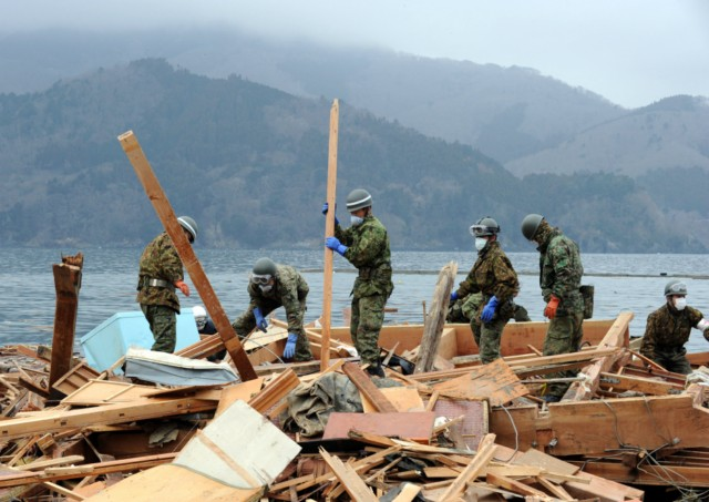 Japanese firemen from the Kyoto City department recover the body of a victim from the wreckage in Minamisanriku, Myagi province, on March 21, 2011, 10 days after a massive earthquake and tsunami ravaged northeastern Japan. The natural disaster -- Japan's deadliest since 1923 -- has left 8,649 people dead and 13,262 missing, after entire communities were swept away by the horrific tsunami or levelled by the record 9.0-magnitude quake.  Miyagi prefecture was worst hit by the quake and tsunami, with a confirmed death toll of 4,882 so far.  AFP PHOTO / PHILIPPE LOPEZ , Japanese firemen search through debris for bodies in Minamisanriku, Myagi province, on March 21, 2011, 10 days after a massive earthquake and tsunami ravaged northeastern Japan. The natural disaster -- Japan's deadliest since 1923 -- has left 8,649 people dead and 13,262 missing, after entire communities were swept away by the horrific tsunami or levelled by the record 9.0-magnitude quake.  Miyagi prefecture was worst hit by the quake and tsunami, with a confirmed death toll of 4,882 so far.  AFP PHOTO / PHILIPPE LOPEZ , A picture shows the rubble and debris 10 days after the massive 9.0 earthquake and tsunami hit the island of Oshima in Miyagi prefecture on March 21, 2011. The March 11 natural disaster -- Japan's deadliest since 1923 -- has left 8,649 people dead and 13,262 missing, after entire communities were swept away by the horrific tsunami or levelled by the record quake.  AFP PHOTO/ Nicolas ASFOURI , A Japanese man stands looking at his destroyed house 10 days after the massive 9.0 earthquake and tsunami hit the island of Oshima in Miyagi prefecture on March 21, 2011. The March 11 natural disaster -- Japan's deadliest since 1923 -- has left 8,649 people dead and 13,262 missing, after entire communities were swept away by the horrific tsunami or levelled by the record quake.  AFP PHOTO/ Nicolas ASFOURI , People walk beside a damaged yacht that was washed up onto a bridge 10 days after the massive 9.0 earthquake and tsunami in Ishinomaki, Miyagi prefecture, on March 21, 2011.  The March 11 natural disaster -- Japan's deadliest since 1923 -- has left 8,649 people dead and 13,262 missing, after entire communities were swept away by the horrific tsunami or levelled by the record quake.    AFP PHOTO/Toru YAMANAKA , A picture shows a boat sticking out of a building 10 days after the massive 9.0 earthquake and tsunami in Ishinomaki, Miyagi prefecture, on March 21, 2011.  The March 11 natural disaster -- Japan's deadliest since 1923 -- has left 8,649 people dead and 13,262 missing, after entire communities were swept away by the horrific tsunami or levelled by the record quake.    AFP PHOTO/Toru YAMANAKA , Cars shifted by the tsunami lie in a swimming pool 10 days after the massive 9.0 earthquake and tsunami in Ishinomaki, Miyagi prefecture, on March 21, 2011.  The March 11 natural disaster -- Japan's deadliest since 1923 -- has left 8,649 people dead and 13,262 missing, after entire communities were swept away by the horrific tsunami or levelled by the record quake.    AFP PHOTO/Toru YAMANAKA , A man walks with his bicycle in front of a destroyed yacht that was washed up onto a bridge 10 days after the massive 9.0 earthquake and tsunami in Ishinomaki, Miyagi prefecture, on March 21, 2011.  The March 11 natural disaster -- Japan's deadliest since 1923 -- has left 8,649 people dead and 13,262 missing, after entire communities were swept away by the horrific tsunami or levelled by the record quake.    AFP PHOTO/Toru YAMANAKA , A woman looks out at the devastation 10 days after the massive 9.0 earthquake and tsunami in Ishinomaki, Miyagi prefecture, on March 21, 2011.  The March 11 natural disaster -- Japan's deadliest since 1923 -- has left 8,649 people dead and 13,262 missing, after entire communities were swept away by the horrific tsunami or levelled by the record 9.0-magnitude quake.    AFP PHOTO/Toru YAMANAKA , A woman picks her way through piles of debris 10 days after the massive 9.0 earthquake and tsunami in Ishinomaki, Miyagi prefecture, on March 21, 2011.  The March 11 natural disaster -- Japan's deadliest since 1923 -- has left 8,649 people dead and 13,262 missing, after entire communities were swept away by the horrific tsunami or levelled by the record 9.0-magnitude quake.    AFP PHOTO/Toru YAMANAKA , A boat sits lodged into the side of a building with a car on its stern close to the port in Ishinomaki in Miyagi prefecture on March 21, 2011. Driving rain on March 21 disrupted rescue efforts in Japan and compounded the misery of disaster survivors now fearing radioactive fallout from the smouldering wreck of a nuclear plant.     AFP PHOTO / MIKE CLARKE , A woman stands in front of a grounded fishing boat and debris in Kesennuma, Miyagi prefecture, on March 21, 2011 after the March 11 tsunami and earthquake devastated northeastern Japan.  Heavy rain along the northeast coast disrupted post-tsunami rescue efforts and compounded the misery of survivors now fearing radioactive fallout from the wrecked Fukushima plant, which has suffered a series of explosions and fires. The March 11 natural disaster -- Japan's deadliest since 1923 -- has left 8,649 people dead and 13,262 missing, after entire communities were swept away by the horrific tsunami or levelled by the record 9.0-magnitude quake. AFP PHOTO / FRED DUFOUR , A picture shows beached fishing boats and debris in Kesennuma, Miyagi prefecture, on March 21, 2011 after the March 11 tsunami and earthquake devastated northeastern Japan.  Heavy rain along the northeast coast disrupted post-tsunami rescue efforts and compounded the misery of survivors now fearing radioactive fallout from the wrecked Fukushima plant, which has suffered a series of explosions and fires. The March 11 natural disaster -- Japan's deadliest since 1923 -- has left 8,649 people dead and 13,262 missing, after entire communities were swept away by the horrific tsunami or levelled by the record 9.0-magnitude quake.  AFP PHOTO/KAZUHIRO NOGI , A general view shows tsunami damage from the March 11 tsunami and earthquake on the island of Oshima in Miyagi prefecture on March 21, 2011. Japan has ordered a halt to shipments of certain foods from four prefectures after abnormal radiation levels were found in products near a quake-hit nuclear plant, a government spokesman said. AFP PHOTO/ Nicolas ASFOURI , A father carries his son on his shoulders as they look out over the devastation to the port city of Kesennuma in Miyagi prefecture on March 21, 2011 10 days after an earthquake and tsunami hit the northeastern coast of Japan. The number of people confirmed dead or listed as missing in Japan neared 22,000, 10 days after a massive earthquake and tsunami struck the country's northeast coast.  AFP PHOTO / JIJI PRESS , Cyclists pedal their bicycles in the water as the road is covered with seawater at Kesennuma city in Miyagi prefecture on March 21, 2011. The number of people confirmed dead or listed as missing in Japan neared 22,000, 10 days after a massive earthquake and tsunami struck the country's northeast coast.  AFP PHOTO / JIJI PRESS , A couple stands in the rubble of there their house was before the March 11 tsunami in the city of Ishinomaki in Miyagi prefecture on March 21, 2011 10 days after an earthquake and tsunami hit the northeastern coast of Japan. The number of people confirmed dead or listed as missing in Japan neared 22,000, 10 days after a massive earthquake and tsunami struck the country's northeast coast.  AFP PHOTO / JIJI PRESS , A picture shows the devastation on the island of Oshima in Miyagi prefecture on March 21, 2011, 10 days after the massive 9.0 earthquake and tsunami. The March 11 natural disaster -- Japan's deadliest since 1923 -- has left 8,649 people dead and 13,262 missing, after entire communities were swept away by the horrific tsunami or levelled by the record quake.  AFP PHOTO/ Nicolas ASFOURI , Japanese officials assess the damage on the island of Oshima in Miyagi prefecture on March 21, 2011, 10 days after the massive 9.0 earthquake and tsunami. The March 11 natural disaster -- Japan's deadliest since 1923 -- has left 8,649 people dead and 13,262 missing, after entire communities were swept away by the horrific tsunami or levelled by the record quake.  AFP PHOTO/ Nicolas ASFOURI , A resident walks amid the debris and rubble on the island of Oshima in Miyagi prefecture on March 21, 2011, 10 days after the massive 9.0 earthquake and tsunami. The March 11 natural disaster -- Japan's deadliest since 1923 -- has left 8,649 people dead and 13,262 missing, after entire communities were swept away by the horrific tsunami or levelled by the record quake.  AFP PHOTO/ Nicolas ASFOURI , Japanese officials assess the damage on the island of Oshima in Miyagi prefecture on March 21, 2011, 10 days after the massive 9.0 earthquake and tsunami. The March 11 natural disaster -- Japan's deadliest since 1923 -- has left 8,649 people dead and 13,262 missing, after entire communities were swept away by the horrific tsunami or levelled by the record quake.  AFP PHOTO/ Nicolas ASFOURI , Japanese officials assess the damage on the island of Oshima in Miyagi prefecture on March 21, 2011, 10 days after the massive 9.0 earthquake and tsunami. The March 11 natural disaster -- Japan's deadliest since 1923 -- has left 8,649 people dead and 13,262 missing, after entire communities were swept away by the horrific tsunami or levelled by the record quake.  AFP PHOTO/ Nicolas ASFOURI , Japanese officials assess the damage as they walk through the debris on the island of Oshima in Miyagi prefecture on March 21, 2011, 10 days after the massive 9.0 earthquake and tsunami. The March 11 natural disaster -- Japan's deadliest since 1923 -- has left 8,649 people dead and 13,262 missing, after entire communities were swept away by the horrific tsunami or levelled by the record quake.  AFP PHOTO/ Nicolas ASFOURI , Japanese officials assess the damage next to a large boat washed up on the island of Oshima in Miyagi prefecture on March 21, 2011, 10 days after the massive 9.0 earthquake and tsunami. The March 11 natural disaster -- Japan's deadliest since 1923 -- has left 8,649 people dead and 13,262 missing, after entire communities were swept away by the horrific tsunami or levelled by the record quake.  AFP PHOTO/ Nicolas ASFOURI , A picture shows the devastation on the island of Oshima in Miyagi prefecture on March 21, 2011, 10 days after the massive 9.0 earthquake and tsunami. The March 11 natural disaster -- Japan's deadliest since 1923 -- has left 8,649 people dead and 13,262 missing, after entire communities were swept away by the horrific tsunami or levelled by the record quake.  AFP PHOTO/ Nicolas ASFOURI , Survivors walk along a street lined with damaged houses on the island of Oshima in Miyagi prefecture on March 21, 2011, 10 days after the massive 9.0 earthquake and tsunami. The March 11 natural disaster -- Japan's deadliest since 1923 -- has left 8,649 people dead and 13,262 missing, after entire communities were swept away by the horrific tsunami or levelled by the record quake.  AFP PHOTO/ Nicolas ASFOURI , A Japanese tsunami survivor sorts through her belongings on the island of Oshima in Miyagi prefecture on March 21, 2011, 10 days after the massive 9.0 earthquake and tsunami. The March 11 natural disaster -- Japan's deadliest since 1923 -- has left 8,649 people dead and 13,262 missing, after entire communities were swept away by the horrific tsunami or levelled by the record quake.  AFP PHOTO/ Nicolas ASFOURI , A bus sits on a building, lodged there by the March 11 tsunami, in the city of Ishinomaki in Miyagi prefecture on March 21, 2011 10 days after an earthquake and tsunami hit the northeastern coast of Japan. . The number of people confirmed dead or listed as missing in Japan neared 22,000, 10 days after a massive earthquake and tsunami struck the country's northeast coast.  AFP PHOTO / JIJI PRESS , A female restaurant owner looks at the area where her restaurant used to stand in the town of Otsuchi in Iwate prefecture on March 21, 2011 10 days after an earthquake and tsunami hit the northeastern coast of Japan. The number of people confirmed dead or listed as missing in Japan neared 22,000, 10 days after a massive earthquake and tsunami struck the country's northeast coast.  AFP PHOTO / JIJI PRESS , A vehicle is lifted onto the rooftop of a collapsed house by the tsunami is pictured in a small village beside the Onagawa nuclear plant in Onagawa in Miyagi prefecture on March 21, 2011. Driving rain on March 21 disrupted rescue efforts in Japan and compounded the misery of disaster survivors now fearing radioactive fallout from the smouldering wreck of a nuclear plant.      AFP PHOTO / TOSHIFUMI KITAMURA , A piece of art work is salvaged by Japanese Self-Defense Force soldiers as they search for missing people in a small village beside the Onagawa nuclear plant in Onagawa in Miyagi prefecture on March 21, 2011. Driving rain on March 21 disrupted rescue efforts in Japan and compounded the misery of disaster survivors now fearing radioactive fallout from the smouldering wreck of a nuclear plant.      AFP PHOTO / TOSHIFUMI KITAMURA , A Japanese Self-Defense Force soldier searches for missing people in a small village beside the Onagawa nuclear plant in Onagawa in Miyagi prefecture on March 21, 2011. Driving rain on March 21 disrupted rescue efforts in Japan and compounded the misery of disaster survivors now fearing radioactive fallout from the smouldering wreck of a nuclear plant.      AFP PHOTO / TOSHIFUMI KITAMURA , Japanese Self-Defense Force soldiers search for missing people in a small village beside the Onagawa nuclear plant in Onagawa in Miyagi prefecture on March 21, 2011. Driving rain on March 21 disrupted rescue efforts in Japan and compounded the misery of disaster survivors now fearing radioactive fallout from the smouldering wreck of a nuclear plant.      AFP PHOTO / TOSHIFUMI KITAMURA