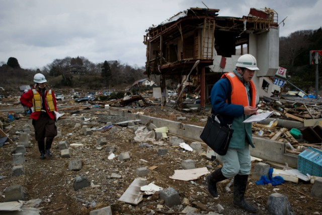 Japanese firemen from the Kyoto City department recover the body of a victim from the wreckage in Minamisanriku, Myagi province, on March 21, 2011, 10 days after a massive earthquake and tsunami ravaged northeastern Japan. The natural disaster -- Japan's deadliest since 1923 -- has left 8,649 people dead and 13,262 missing, after entire communities were swept away by the horrific tsunami or levelled by the record 9.0-magnitude quake.  Miyagi prefecture was worst hit by the quake and tsunami, with a confirmed death toll of 4,882 so far.  AFP PHOTO / PHILIPPE LOPEZ , Japanese firemen search through debris for bodies in Minamisanriku, Myagi province, on March 21, 2011, 10 days after a massive earthquake and tsunami ravaged northeastern Japan. The natural disaster -- Japan's deadliest since 1923 -- has left 8,649 people dead and 13,262 missing, after entire communities were swept away by the horrific tsunami or levelled by the record 9.0-magnitude quake.  Miyagi prefecture was worst hit by the quake and tsunami, with a confirmed death toll of 4,882 so far.  AFP PHOTO / PHILIPPE LOPEZ , A picture shows the rubble and debris 10 days after the massive 9.0 earthquake and tsunami hit the island of Oshima in Miyagi prefecture on March 21, 2011. The March 11 natural disaster -- Japan's deadliest since 1923 -- has left 8,649 people dead and 13,262 missing, after entire communities were swept away by the horrific tsunami or levelled by the record quake.  AFP PHOTO/ Nicolas ASFOURI , A Japanese man stands looking at his destroyed house 10 days after the massive 9.0 earthquake and tsunami hit the island of Oshima in Miyagi prefecture on March 21, 2011. The March 11 natural disaster -- Japan's deadliest since 1923 -- has left 8,649 people dead and 13,262 missing, after entire communities were swept away by the horrific tsunami or levelled by the record quake.  AFP PHOTO/ Nicolas ASFOURI , People walk beside a damaged yacht that was washed up onto a bridge 10 days after the massive 9.0 earthquake and tsunami in Ishinomaki, Miyagi prefecture, on March 21, 2011.  The March 11 natural disaster -- Japan's deadliest since 1923 -- has left 8,649 people dead and 13,262 missing, after entire communities were swept away by the horrific tsunami or levelled by the record quake.    AFP PHOTO/Toru YAMANAKA , A picture shows a boat sticking out of a building 10 days after the massive 9.0 earthquake and tsunami in Ishinomaki, Miyagi prefecture, on March 21, 2011.  The March 11 natural disaster -- Japan's deadliest since 1923 -- has left 8,649 people dead and 13,262 missing, after entire communities were swept away by the horrific tsunami or levelled by the record quake.    AFP PHOTO/Toru YAMANAKA , Cars shifted by the tsunami lie in a swimming pool 10 days after the massive 9.0 earthquake and tsunami in Ishinomaki, Miyagi prefecture, on March 21, 2011.  The March 11 natural disaster -- Japan's deadliest since 1923 -- has left 8,649 people dead and 13,262 missing, after entire communities were swept away by the horrific tsunami or levelled by the record quake.    AFP PHOTO/Toru YAMANAKA , A man walks with his bicycle in front of a destroyed yacht that was washed up onto a bridge 10 days after the massive 9.0 earthquake and tsunami in Ishinomaki, Miyagi prefecture, on March 21, 2011.  The March 11 natural disaster -- Japan's deadliest since 1923 -- has left 8,649 people dead and 13,262 missing, after entire communities were swept away by the horrific tsunami or levelled by the record quake.    AFP PHOTO/Toru YAMANAKA , A woman looks out at the devastation 10 days after the massive 9.0 earthquake and tsunami in Ishinomaki, Miyagi prefecture, on March 21, 2011.  The March 11 natural disaster -- Japan's deadliest since 1923 -- has left 8,649 people dead and 13,262 missing, after entire communities were swept away by the horrific tsunami or levelled by the record 9.0-magnitude quake.    AFP PHOTO/Toru YAMANAKA , A woman picks her way through piles of debris 10 days after the massive 9.0 earthquake and tsunami in Ishinomaki, Miyagi prefecture, on March 21, 2011.  The March 11 natural disaster -- Japan's deadliest since 1923 -- has left 8,649 people dead and 13,262 missing, after entire communities were swept away by the horrific tsunami or levelled by the record 9.0-magnitude quake.    AFP PHOTO/Toru YAMANAKA , A boat sits lodged into the side of a building with a car on its stern close to the port in Ishinomaki in Miyagi prefecture on March 21, 2011. Driving rain on March 21 disrupted rescue efforts in Japan and compounded the misery of disaster survivors now fearing radioactive fallout from the smouldering wreck of a nuclear plant.     AFP PHOTO / MIKE CLARKE , A woman stands in front of a grounded fishing boat and debris in Kesennuma, Miyagi prefecture, on March 21, 2011 after the March 11 tsunami and earthquake devastated northeastern Japan.  Heavy rain along the northeast coast disrupted post-tsunami rescue efforts and compounded the misery of survivors now fearing radioactive fallout from the wrecked Fukushima plant, which has suffered a series of explosions and fires. The March 11 natural disaster -- Japan's deadliest since 1923 -- has left 8,649 people dead and 13,262 missing, after entire communities were swept away by the horrific tsunami or levelled by the record 9.0-magnitude quake. AFP PHOTO / FRED DUFOUR , A picture shows beached fishing boats and debris in Kesennuma, Miyagi prefecture, on March 21, 2011 after the March 11 tsunami and earthquake devastated northeastern Japan.  Heavy rain along the northeast coast disrupted post-tsunami rescue efforts and compounded the misery of survivors now fearing radioactive fallout from the wrecked Fukushima plant, which has suffered a series of explosions and fires. The March 11 natural disaster -- Japan's deadliest since 1923 -- has left 8,649 people dead and 13,262 missing, after entire communities were swept away by the horrific tsunami or levelled by the record 9.0-magnitude quake.  AFP PHOTO/KAZUHIRO NOGI , A general view shows tsunami damage from the March 11 tsunami and earthquake on the island of Oshima in Miyagi prefecture on March 21, 2011. Japan has ordered a halt to shipments of certain foods from four prefectures after abnormal radiation levels were found in products near a quake-hit nuclear plant, a government spokesman said. AFP PHOTO/ Nicolas ASFOURI , A father carries his son on his shoulders as they look out over the devastation to the port city of Kesennuma in Miyagi prefecture on March 21, 2011 10 days after an earthquake and tsunami hit the northeastern coast of Japan. The number of people confirmed dead or listed as missing in Japan neared 22,000, 10 days after a massive earthquake and tsunami struck the country's northeast coast.  AFP PHOTO / JIJI PRESS , Cyclists pedal their bicycles in the water as the road is covered with seawater at Kesennuma city in Miyagi prefecture on March 21, 2011. The number of people confirmed dead or listed as missing in Japan neared 22,000, 10 days after a massive earthquake and tsunami struck the country's northeast coast.  AFP PHOTO / JIJI PRESS , A couple stands in the rubble of there their house was before the March 11 tsunami in the city of Ishinomaki in Miyagi prefecture on March 21, 2011 10 days after an earthquake and tsunami hit the northeastern coast of Japan. The number of people confirmed dead or listed as missing in Japan neared 22,000, 10 days after a massive earthquake and tsunami struck the country's northeast coast.  AFP PHOTO / JIJI PRESS , A picture shows the devastation on the island of Oshima in Miyagi prefecture on March 21, 2011, 10 days after the massive 9.0 earthquake and tsunami. The March 11 natural disaster -- Japan's deadliest since 1923 -- has left 8,649 people dead and 13,262 missing, after entire communities were swept away by the horrific tsunami or levelled by the record quake.  AFP PHOTO/ Nicolas ASFOURI , Japanese officials assess the damage on the island of Oshima in Miyagi prefecture on March 21, 2011, 10 days after the massive 9.0 earthquake and tsunami. The March 11 natural disaster -- Japan's deadliest since 1923 -- has left 8,649 people dead and 13,262 missing, after entire communities were swept away by the horrific tsunami or levelled by the record quake.  AFP PHOTO/ Nicolas ASFOURI , A resident walks amid the debris and rubble on the island of Oshima in Miyagi prefecture on March 21, 2011, 10 days after the massive 9.0 earthquake and tsunami. The March 11 natural disaster -- Japan's deadliest since 1923 -- has left 8,649 people dead and 13,262 missing, after entire communities were swept away by the horrific tsunami or levelled by the record quake.  AFP PHOTO/ Nicolas ASFOURI , Japanese officials assess the damage on the island of Oshima in Miyagi prefecture on March 21, 2011, 10 days after the massive 9.0 earthquake and tsunami. The March 11 natural disaster -- Japan's deadliest since 1923 -- has left 8,649 people dead and 13,262 missing, after entire communities were swept away by the horrific tsunami or levelled by the record quake.  AFP PHOTO/ Nicolas ASFOURI , Japanese officials assess the damage on the island of Oshima in Miyagi prefecture on March 21, 2011, 10 days after the massive 9.0 earthquake and tsunami. The March 11 natural disaster -- Japan's deadliest since 1923 -- has left 8,649 people dead and 13,262 missing, after entire communities were swept away by the horrific tsunami or levelled by the record quake.  AFP PHOTO/ Nicolas ASFOURI , Japanese officials assess the damage as they walk through the debris on the island of Oshima in Miyagi prefecture on March 21, 2011, 10 days after the massive 9.0 earthquake and tsunami. The March 11 natural disaster -- Japan's deadliest since 1923 -- has left 8,649 people dead and 13,262 missing, after entire communities were swept away by the horrific tsunami or levelled by the record quake.  AFP PHOTO/ Nicolas ASFOURI