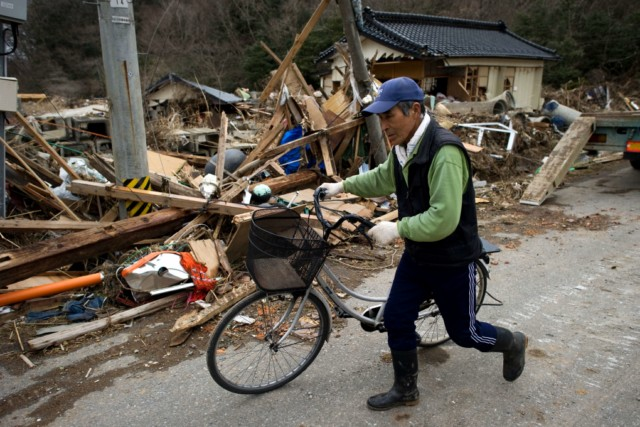 Japanese firemen from the Kyoto City department recover the body of a victim from the wreckage in Minamisanriku, Myagi province, on March 21, 2011, 10 days after a massive earthquake and tsunami ravaged northeastern Japan. The natural disaster -- Japan's deadliest since 1923 -- has left 8,649 people dead and 13,262 missing, after entire communities were swept away by the horrific tsunami or levelled by the record 9.0-magnitude quake.  Miyagi prefecture was worst hit by the quake and tsunami, with a confirmed death toll of 4,882 so far.  AFP PHOTO / PHILIPPE LOPEZ , Japanese firemen search through debris for bodies in Minamisanriku, Myagi province, on March 21, 2011, 10 days after a massive earthquake and tsunami ravaged northeastern Japan. The natural disaster -- Japan's deadliest since 1923 -- has left 8,649 people dead and 13,262 missing, after entire communities were swept away by the horrific tsunami or levelled by the record 9.0-magnitude quake.  Miyagi prefecture was worst hit by the quake and tsunami, with a confirmed death toll of 4,882 so far.  AFP PHOTO / PHILIPPE LOPEZ , A picture shows the rubble and debris 10 days after the massive 9.0 earthquake and tsunami hit the island of Oshima in Miyagi prefecture on March 21, 2011. The March 11 natural disaster -- Japan's deadliest since 1923 -- has left 8,649 people dead and 13,262 missing, after entire communities were swept away by the horrific tsunami or levelled by the record quake.  AFP PHOTO/ Nicolas ASFOURI , A Japanese man stands looking at his destroyed house 10 days after the massive 9.0 earthquake and tsunami hit the island of Oshima in Miyagi prefecture on March 21, 2011. The March 11 natural disaster -- Japan's deadliest since 1923 -- has left 8,649 people dead and 13,262 missing, after entire communities were swept away by the horrific tsunami or levelled by the record quake.  AFP PHOTO/ Nicolas ASFOURI , People walk beside a damaged yacht that was washed up onto a bridge 10 days after the massive 9.0 earthquake and tsunami in Ishinomaki, Miyagi prefecture, on March 21, 2011.  The March 11 natural disaster -- Japan's deadliest since 1923 -- has left 8,649 people dead and 13,262 missing, after entire communities were swept away by the horrific tsunami or levelled by the record quake.    AFP PHOTO/Toru YAMANAKA , A picture shows a boat sticking out of a building 10 days after the massive 9.0 earthquake and tsunami in Ishinomaki, Miyagi prefecture, on March 21, 2011.  The March 11 natural disaster -- Japan's deadliest since 1923 -- has left 8,649 people dead and 13,262 missing, after entire communities were swept away by the horrific tsunami or levelled by the record quake.    AFP PHOTO/Toru YAMANAKA , Cars shifted by the tsunami lie in a swimming pool 10 days after the massive 9.0 earthquake and tsunami in Ishinomaki, Miyagi prefecture, on March 21, 2011.  The March 11 natural disaster -- Japan's deadliest since 1923 -- has left 8,649 people dead and 13,262 missing, after entire communities were swept away by the horrific tsunami or levelled by the record quake.    AFP PHOTO/Toru YAMANAKA , A man walks with his bicycle in front of a destroyed yacht that was washed up onto a bridge 10 days after the massive 9.0 earthquake and tsunami in Ishinomaki, Miyagi prefecture, on March 21, 2011.  The March 11 natural disaster -- Japan's deadliest since 1923 -- has left 8,649 people dead and 13,262 missing, after entire communities were swept away by the horrific tsunami or levelled by the record quake.    AFP PHOTO/Toru YAMANAKA , A woman looks out at the devastation 10 days after the massive 9.0 earthquake and tsunami in Ishinomaki, Miyagi prefecture, on March 21, 2011.  The March 11 natural disaster -- Japan's deadliest since 1923 -- has left 8,649 people dead and 13,262 missing, after entire communities were swept away by the horrific tsunami or levelled by the record 9.0-magnitude quake.    AFP PHOTO/Toru YAMANAKA , A woman picks her way through piles of debris 10 days after the massive 9.0 earthquake and tsunami in Ishinomaki, Miyagi prefecture, on March 21, 2011.  The March 11 natural disaster -- Japan's deadliest since 1923 -- has left 8,649 people dead and 13,262 missing, after entire communities were swept away by the horrific tsunami or levelled by the record 9.0-magnitude quake.    AFP PHOTO/Toru YAMANAKA , A boat sits lodged into the side of a building with a car on its stern close to the port in Ishinomaki in Miyagi prefecture on March 21, 2011. Driving rain on March 21 disrupted rescue efforts in Japan and compounded the misery of disaster survivors now fearing radioactive fallout from the smouldering wreck of a nuclear plant.     AFP PHOTO / MIKE CLARKE , A woman stands in front of a grounded fishing boat and debris in Kesennuma, Miyagi prefecture, on March 21, 2011 after the March 11 tsunami and earthquake devastated northeastern Japan.  Heavy rain along the northeast coast disrupted post-tsunami rescue efforts and compounded the misery of survivors now fearing radioactive fallout from the wrecked Fukushima plant, which has suffered a series of explosions and fires. The March 11 natural disaster -- Japan's deadliest since 1923 -- has left 8,649 people dead and 13,262 missing, after entire communities were swept away by the horrific tsunami or levelled by the record 9.0-magnitude quake. AFP PHOTO / FRED DUFOUR , A picture shows beached fishing boats and debris in Kesennuma, Miyagi prefecture, on March 21, 2011 after the March 11 tsunami and earthquake devastated northeastern Japan.  Heavy rain along the northeast coast disrupted post-tsunami rescue efforts and compounded the misery of survivors now fearing radioactive fallout from the wrecked Fukushima plant, which has suffered a series of explosions and fires. The March 11 natural disaster -- Japan's deadliest since 1923 -- has left 8,649 people dead and 13,262 missing, after entire communities were swept away by the horrific tsunami or levelled by the record 9.0-magnitude quake.  AFP PHOTO/KAZUHIRO NOGI , A general view shows tsunami damage from the March 11 tsunami and earthquake on the island of Oshima in Miyagi prefecture on March 21, 2011. Japan has ordered a halt to shipments of certain foods from four prefectures after abnormal radiation levels were found in products near a quake-hit nuclear plant, a government spokesman said. AFP PHOTO/ Nicolas ASFOURI , A father carries his son on his shoulders as they look out over the devastation to the port city of Kesennuma in Miyagi prefecture on March 21, 2011 10 days after an earthquake and tsunami hit the northeastern coast of Japan. The number of people confirmed dead or listed as missing in Japan neared 22,000, 10 days after a massive earthquake and tsunami struck the country's northeast coast.  AFP PHOTO / JIJI PRESS , Cyclists pedal their bicycles in the water as the road is covered with seawater at Kesennuma city in Miyagi prefecture on March 21, 2011. The number of people confirmed dead or listed as missing in Japan neared 22,000, 10 days after a massive earthquake and tsunami struck the country's northeast coast.  AFP PHOTO / JIJI PRESS , A couple stands in the rubble of there their house was before the March 11 tsunami in the city of Ishinomaki in Miyagi prefecture on March 21, 2011 10 days after an earthquake and tsunami hit the northeastern coast of Japan. The number of people confirmed dead or listed as missing in Japan neared 22,000, 10 days after a massive earthquake and tsunami struck the country's northeast coast.  AFP PHOTO / JIJI PRESS , A picture shows the devastation on the island of Oshima in Miyagi prefecture on March 21, 2011, 10 days after the massive 9.0 earthquake and tsunami. The March 11 natural disaster -- Japan's deadliest since 1923 -- has left 8,649 people dead and 13,262 missing, after entire communities were swept away by the horrific tsunami or levelled by the record quake.  AFP PHOTO/ Nicolas ASFOURI , Japanese officials assess the damage on the island of Oshima in Miyagi prefecture on March 21, 2011, 10 days after the massive 9.0 earthquake and tsunami. The March 11 natural disaster -- Japan's deadliest since 1923 -- has left 8,649 people dead and 13,262 missing, after entire communities were swept away by the horrific tsunami or levelled by the record quake.  AFP PHOTO/ Nicolas ASFOURI , A resident walks amid the debris and rubble on the island of Oshima in Miyagi prefecture on March 21, 2011, 10 days after the massive 9.0 earthquake and tsunami. The March 11 natural disaster -- Japan's deadliest since 1923 -- has left 8,649 people dead and 13,262 missing, after entire communities were swept away by the horrific tsunami or levelled by the record quake.  AFP PHOTO/ Nicolas ASFOURI