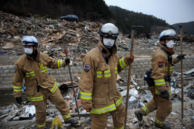 Japanese firemen from the Kyoto City department recover the body of a victim from the wreckage in Minamisanriku, Myagi province, on March 21, 2011, 10 days after a massive earthquake and tsunami ravaged northeastern Japan. The natural disaster -- Japan's deadliest since 1923 -- has left 8,649 people dead and 13,262 missing, after entire communities were swept away by the horrific tsunami or levelled by the record 9.0-magnitude quake.  Miyagi prefecture was worst hit by the quake and tsunami, with a confirmed death toll of 4,882 so far.  AFP PHOTO / PHILIPPE LOPEZ , Japanese firemen search through debris for bodies in Minamisanriku, Myagi province, on March 21, 2011, 10 days after a massive earthquake and tsunami ravaged northeastern Japan. The natural disaster -- Japan's deadliest since 1923 -- has left 8,649 people dead and 13,262 missing, after entire communities were swept away by the horrific tsunami or levelled by the record 9.0-magnitude quake.  Miyagi prefecture was worst hit by the quake and tsunami, with a confirmed death toll of 4,882 so far.  AFP PHOTO / PHILIPPE LOPEZ , A picture shows the rubble and debris 10 days after the massive 9.0 earthquake and tsunami hit the island of Oshima in Miyagi prefecture on March 21, 2011. The March 11 natural disaster -- Japan's deadliest since 1923 -- has left 8,649 people dead and 13,262 missing, after entire communities were swept away by the horrific tsunami or levelled by the record quake.  AFP PHOTO/ Nicolas ASFOURI , A Japanese man stands looking at his destroyed house 10 days after the massive 9.0 earthquake and tsunami hit the island of Oshima in Miyagi prefecture on March 21, 2011. The March 11 natural disaster -- Japan's deadliest since 1923 -- has left 8,649 people dead and 13,262 missing, after entire communities were swept away by the horrific tsunami or levelled by the record quake.  AFP PHOTO/ Nicolas ASFOURI , People walk beside a damaged yacht that was washed up onto a bridge 10 days after the massive 9.0 earthquake and tsunami in Ishinomaki, Miyagi prefecture, on March 21, 2011.  The March 11 natural disaster -- Japan's deadliest since 1923 -- has left 8,649 people dead and 13,262 missing, after entire communities were swept away by the horrific tsunami or levelled by the record quake.    AFP PHOTO/Toru YAMANAKA , A picture shows a boat sticking out of a building 10 days after the massive 9.0 earthquake and tsunami in Ishinomaki, Miyagi prefecture, on March 21, 2011.  The March 11 natural disaster -- Japan's deadliest since 1923 -- has left 8,649 people dead and 13,262 missing, after entire communities were swept away by the horrific tsunami or levelled by the record quake.    AFP PHOTO/Toru YAMANAKA , Cars shifted by the tsunami lie in a swimming pool 10 days after the massive 9.0 earthquake and tsunami in Ishinomaki, Miyagi prefecture, on March 21, 2011.  The March 11 natural disaster -- Japan's deadliest since 1923 -- has left 8,649 people dead and 13,262 missing, after entire communities were swept away by the horrific tsunami or levelled by the record quake.    AFP PHOTO/Toru YAMANAKA , A man walks with his bicycle in front of a destroyed yacht that was washed up onto a bridge 10 days after the massive 9.0 earthquake and tsunami in Ishinomaki, Miyagi prefecture, on March 21, 2011.  The March 11 natural disaster -- Japan's deadliest since 1923 -- has left 8,649 people dead and 13,262 missing, after entire communities were swept away by the horrific tsunami or levelled by the record quake.    AFP PHOTO/Toru YAMANAKA , A woman looks out at the devastation 10 days after the massive 9.0 earthquake and tsunami in Ishinomaki, Miyagi prefecture, on March 21, 2011.  The March 11 natural disaster -- Japan's deadliest since 1923 -- has left 8,649 people dead and 13,262 missing, after entire communities were swept away by the horrific tsunami or levelled by the record 9.0-magnitude quake.    AFP PHOTO/Toru YAMANAKA , A woman picks her way through piles of debris 10 days after the massive 9.0 earthquake and tsunami in Ishinomaki, Miyagi prefecture, on March 21, 2011.  The March 11 natural disaster -- Japan's deadliest since 1923 -- has left 8,649 people dead and 13,262 missing, after entire communities were swept away by the horrific tsunami or levelled by the record 9.0-magnitude quake.    AFP PHOTO/Toru YAMANAKA , A boat sits lodged into the side of a building with a car on its stern close to the port in Ishinomaki in Miyagi prefecture on March 21, 2011. Driving rain on March 21 disrupted rescue efforts in Japan and compounded the misery of disaster survivors now fearing radioactive fallout from the smouldering wreck of a nuclear plant.     AFP PHOTO / MIKE CLARKE , A woman stands in front of a grounded fishing boat and debris in Kesennuma, Miyagi prefecture, on March 21, 2011 after the March 11 tsunami and earthquake devastated northeastern Japan.  Heavy rain along the northeast coast disrupted post-tsunami rescue efforts and compounded the misery of survivors now fearing radioactive fallout from the wrecked Fukushima plant, which has suffered a series of explosions and fires. The March 11 natural disaster -- Japan's deadliest since 1923 -- has left 8,649 people dead and 13,262 missing, after entire communities were swept away by the horrific tsunami or levelled by the record 9.0-magnitude quake. AFP PHOTO / FRED DUFOUR , A picture shows beached fishing boats and debris in Kesennuma, Miyagi prefecture, on March 21, 2011 after the March 11 tsunami and earthquake devastated northeastern Japan.  Heavy rain along the northeast coast disrupted post-tsunami rescue efforts and compounded the misery of survivors now fearing radioactive fallout from the wrecked Fukushima plant, which has suffered a series of explosions and fires. The March 11 natural disaster -- Japan's deadliest since 1923 -- has left 8,649 people dead and 13,262 missing, after entire communities were swept away by the horrific tsunami or levelled by the record 9.0-magnitude quake.  AFP PHOTO/KAZUHIRO NOGI , A general view shows tsunami damage from the March 11 tsunami and earthquake on the island of Oshima in Miyagi prefecture on March 21, 2011. Japan has ordered a halt to shipments of certain foods from four prefectures after abnormal radiation levels were found in products near a quake-hit nuclear plant, a government spokesman said. AFP PHOTO/ Nicolas ASFOURI , A father carries his son on his shoulders as they look out over the devastation to the port city of Kesennuma in Miyagi prefecture on March 21, 2011 10 days after an earthquake and tsunami hit the northeastern coast of Japan. The number of people confirmed dead or listed as missing in Japan neared 22,000, 10 days after a massive earthquake and tsunami struck the country's northeast coast.  AFP PHOTO / JIJI PRESS , Cyclists pedal their bicycles in the water as the road is covered with seawater at Kesennuma city in Miyagi prefecture on March 21, 2011. The number of people confirmed dead or listed as missing in Japan neared 22,000, 10 days after a massive earthquake and tsunami struck the country's northeast coast.  AFP PHOTO / JIJI PRESS , A couple stands in the rubble of there their house was before the March 11 tsunami in the city of Ishinomaki in Miyagi prefecture on March 21, 2011 10 days after an earthquake and tsunami hit the northeastern coast of Japan. The number of people confirmed dead or listed as missing in Japan neared 22,000, 10 days after a massive earthquake and tsunami struck the country's northeast coast.  AFP PHOTO / JIJI PRESS , A picture shows the devastation on the island of Oshima in Miyagi prefecture on March 21, 2011, 10 days after the massive 9.0 earthquake and tsunami. The March 11 natural disaster -- Japan's deadliest since 1923 -- has left 8,649 people dead and 13,262 missing, after entire communities were swept away by the horrific tsunami or levelled by the record quake.  AFP PHOTO/ Nicolas ASFOURI , Japanese officials assess the damage on the island of Oshima in Miyagi prefecture on March 21, 2011, 10 days after the massive 9.0 earthquake and tsunami. The March 11 natural disaster -- Japan's deadliest since 1923 -- has left 8,649 people dead and 13,262 missing, after entire communities were swept away by the horrific tsunami or levelled by the record quake.  AFP PHOTO/ Nicolas ASFOURI , A resident walks amid the debris and rubble on the island of Oshima in Miyagi prefecture on March 21, 2011, 10 days after the massive 9.0 earthquake and tsunami. The March 11 natural disaster -- Japan's deadliest since 1923 -- has left 8,649 people dead and 13,262 missing, after entire communities were swept away by the horrific tsunami or levelled by the record quake.  AFP PHOTO/ Nicolas ASFOURI , Japanese officials assess the damage on the island of Oshima in Miyagi prefecture on March 21, 2011, 10 days after the massive 9.0 earthquake and tsunami. The March 11 natural disaster -- Japan's deadliest since 1923 -- has left 8,649 people dead and 13,262 missing, after entire communities were swept away by the horrific tsunami or levelled by the record quake.  AFP PHOTO/ Nicolas ASFOURI , Japanese officials assess the damage on the island of Oshima in Miyagi prefecture on March 21, 2011, 10 days after the massive 9.0 earthquake and tsunami. The March 11 natural disaster -- Japan's deadliest since 1923 -- has left 8,649 people dead and 13,262 missing, after entire communities were swept away by the horrific tsunami or levelled by the record quake.  AFP PHOTO/ Nicolas ASFOURI , Japanese officials assess the damage as they walk through the debris on the island of Oshima in Miyagi prefecture on March 21, 2011, 10 days after the massive 9.0 earthquake and tsunami. The March 11 natural disaster -- Japan's deadliest since 1923 -- has left 8,649 people dead and 13,262 missing, after entire communities were swept away by the horrific tsunami or levelled by the record quake.  AFP PHOTO/ Nicolas ASFOURI , Japanese officials assess the damage next to a large boat washed up on the island of Oshima in Miyagi prefecture on March 21, 2011, 10 days after the massive 9.0 earthquake and tsunami. The March 11 natural disaster -- Japan's deadliest since 1923 -- has left 8,649 people dead and 13,262 missing, after entire communities were swept away by the horrific tsunami or levelled by the record quake.  AFP PHOTO/ Nicolas ASFOURI , A picture shows the devastation on the island of Oshima in Miyagi prefecture on March 21, 2011, 10 days after the massive 9.0 earthquake and tsunami. The March 11 natural disaster -- Japan's deadliest since 1923 -- has left 8,649 people dead and 13,262 missing, after entire communities were swept away by the horrific tsunami or levelled by the record quake.  AFP PHOTO/ Nicolas ASFOURI , Survivors walk along a street lined with damaged houses on the island of Oshima in Miyagi prefecture on March 21, 2011, 10 days after the massive 9.0 earthquake and tsunami. The March 11 natural disaster -- Japan's deadliest since 1923 -- has left 8,649 people dead and 13,262 missing, after entire communities were swept away by the horrific tsunami or levelled by the record quake.  AFP PHOTO/ Nicolas ASFOURI , A Japanese tsunami survivor sorts through her belongings on the island of Oshima in Miyagi prefecture on March 21, 2011, 10 days after the massive 9.0 earthquake and tsunami. The March 11 natural disaster -- Japan's deadliest since 1923 -- has left 8,649 people dead and 13,262 missing, after entire communities were swept away by the horrific tsunami or levelled by the record quake.  AFP PHOTO/ Nicolas ASFOURI , A bus sits on a building, lodged there by the March 11 tsunami, in the city of Ishinomaki in Miyagi prefecture on March 21, 2011 10 days after an earthquake and tsunami hit the northeastern coast of Japan. . The number of people confirmed dead or listed as missing in Japan neared 22,000, 10 days after a massive earthquake and tsunami struck the country's northeast coast.  AFP PHOTO / JIJI PRESS , A female restaurant owner looks at the area where her restaurant used to stand in the town of Otsuchi in Iwate prefecture on March 21, 2011 10 days after an earthquake and tsunami hit the northeastern coast of Japan. The number of people confirmed dead or listed as missing in Japan neared 22,000, 10 days after a massive earthquake and tsunami struck the country's northeast coast.  AFP PHOTO / JIJI PRESS , A vehicle is lifted onto the rooftop of a collapsed house by the tsunami is pictured in a small village beside the Onagawa nuclear plant in Onagawa in Miyagi prefecture on March 21, 2011. Driving rain on March 21 disrupted rescue efforts in Japan and compounded the misery of disaster survivors now fearing radioactive fallout from the smouldering wreck of a nuclear plant.      AFP PHOTO / TOSHIFUMI KITAMURA , A piece of art work is salvaged by Japanese Self-Defense Force soldiers as they search for missing people in a small village beside the Onagawa nuclear plant in Onagawa in Miyagi prefecture on March 21, 2011. Driving rain on March 21 disrupted rescue efforts in Japan and compounded the misery of disaster survivors now fearing radioactive fallout from the smouldering wreck of a nuclear plant.      AFP PHOTO / TOSHIFUMI KITAMURA , A Japanese Self-Defense Force soldier searches for missing people in a small village beside the Onagawa nuclear plant in Onagawa in Miyagi prefecture on March 21, 2011. Driving rain on March 21 disrupted rescue efforts in Japan and compounded the misery of disaster survivors now fearing radioactive fallout from the smouldering wreck of a nuclear plant.      AFP PHOTO / TOSHIFUMI KITAMURA , Japanese Self-Defense Force soldiers search for missing people in a small village beside the Onagawa nuclear plant in Onagawa in Miyagi prefecture on March 21, 2011. Driving rain on March 21 disrupted rescue efforts in Japan and compounded the misery of disaster survivors now fearing radioactive fallout from the smouldering wreck of a nuclear plant.      AFP PHOTO / TOSHIFUMI KITAMURA , Japanese Self-Defense Force soldiers search for missing people in a small village beside the Onagawa nuclear plant in Onagawa in Miyagi prefecture on March 21, 2011. Driving rain on March 21 disrupted rescue efforts in Japan and compounded the misery of disaster survivors now fearing radioactive fallout from the smouldering wreck of a nuclear plant.      AFP PHOTO / TOSHIFUMI KITAMURA , Japanese Self-Defense Force soldiers search for missing people in a small village beside the Onagawa nuclear plant in Onagawa in Miyagi prefecture on March 21, 2011. Driving rain on March 21 disrupted rescue efforts in Japan and compounded the misery of disaster survivors now fearing radioactive fallout from the smouldering wreck of a nuclear plant.      AFP PHOTO / TOSHIFUMI KITAMURA , Two people chat as they prepare food while taking a break from cleaning up their destroyed shop  in the devastated city of Ishinomaki on March 21, 2011 following the deadly March 11 earthquake and tsunami that hit the northeastern coast of Japan's main island of Honshu.          AFP PHOTO/Nicholas KAMM , A woman walks amid the rubble in the devastated city of  Ishinomaki on March 21, 2011 following the deadly March 11 earthquake and tsunami that hit the northeastern coast of Japan's main island of Honshu.          AFP PHOTO/Nicholas KAMM , Japanese firemen search for bodies in Minamisanriku, Myagi province, on March 21, 2011, 10 days after a massive earthquake and tsunami ravaged northeastern Japan. The natural disaster -- Japan's deadliest since 1923 -- has left 8,649 people dead and 13,262 missing, after entire communities were swept away by the horrific tsunami or levelled by the record 9.0-magnitude quake.  Miyagi prefecture was worst hit by the quake and tsunami, with a confirmed death toll of 4,882 so far.  AFP PHOTO / PHILIPPE LOPEZ