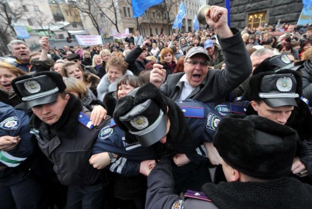 People shout slogans and hold banner as they try to block the traffic in front of policemen during a rally near the Ukraine's Cabinet of the Ministers in Kiev, on March 22, 2011. Some 5,000 of Ukrainian school teachers, lecturers and professors demanded a salary increase and more financing for education. AFP PHOTO/ SERGEI SUPINSKY , A woman speaks to a policeman during rally in front of the Ukraine's Cabinet of the Ministers, in Kiev, on March 22, 2011. Some 5,000 of Ukrainian school teachers, lecturers and professors protested today to demand a salary increase and more financing for education. AFP PHOTO/ SERGEI SUPINSKY , People clash with police as they try to block the traffic on a road during rally in front of the Ukraine's Cabinet of the Ministers in Kiev on March 22, 2011. Some 5,000 of Ukrainian school teachers, lecturers and professors demanded a salary increase and more financing for education. AFP PHOTO/ SERGEI SUPINSKY