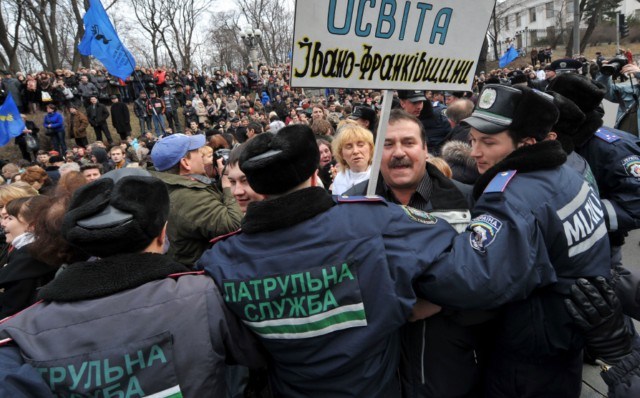 People shout slogans and hold banner as they try to block the traffic in front of policemen during a rally near the Ukraine's Cabinet of the Ministers in Kiev, on March 22, 2011. Some 5,000 of Ukrainian school teachers, lecturers and professors demanded a salary increase and more financing for education. AFP PHOTO/ SERGEI SUPINSKY , A woman speaks to a policeman during rally in front of the Ukraine's Cabinet of the Ministers, in Kiev, on March 22, 2011. Some 5,000 of Ukrainian school teachers, lecturers and professors protested today to demand a salary increase and more financing for education. AFP PHOTO/ SERGEI SUPINSKY , People clash with police as they try to block the traffic on a road during rally in front of the Ukraine's Cabinet of the Ministers in Kiev on March 22, 2011. Some 5,000 of Ukrainian school teachers, lecturers and professors demanded a salary increase and more financing for education. AFP PHOTO/ SERGEI SUPINSKY , People clash with police as they try to block the traffic on a road during rally in front of the Ukraine's Cabinet of the Ministers in Kiev on March 22, 2011. Some 5,000 of Ukrainian school teachers, lecturers and professors demanded a salary increase and more financing for education. AFP PHOTO/ SERGEI SUPINSKY , People clash with police as they try to block the traffic on a road during rally in front of the Ukraine's Cabinet of the Ministers in Kiev on March 22, 2011. Some 5,000 of Ukrainian school teachers, lecturers and professors demanded a salary increase and more financing for education. AFP PHOTO/ SERGEI SUPINSKY , People clash with police as they try to block the traffic on a road during rally in front of the Ukraine's Cabinet of the Ministers in Kiev on March 22, 2011. Some 5,000 of Ukrainian school teachers, lecturers and professors demanded a salary increase and more financing for education. AFP PHOTO/ SERGEI SUPINSKY