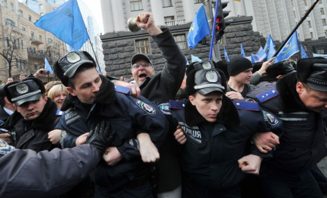 People shout slogans and hold banner as they try to block the traffic in front of policemen during a rally near the Ukraine's Cabinet of the Ministers in Kiev, on March 22, 2011. Some 5,000 of Ukrainian school teachers, lecturers and professors demanded a salary increase and more financing for education. AFP PHOTO/ SERGEI SUPINSKY , A woman speaks to a policeman during rally in front of the Ukraine's Cabinet of the Ministers, in Kiev, on March 22, 2011. Some 5,000 of Ukrainian school teachers, lecturers and professors protested today to demand a salary increase and more financing for education. AFP PHOTO/ SERGEI SUPINSKY , People clash with police as they try to block the traffic on a road during rally in front of the Ukraine's Cabinet of the Ministers in Kiev on March 22, 2011. Some 5,000 of Ukrainian school teachers, lecturers and professors demanded a salary increase and more financing for education. AFP PHOTO/ SERGEI SUPINSKY , People clash with police as they try to block the traffic on a road during rally in front of the Ukraine's Cabinet of the Ministers in Kiev on March 22, 2011. Some 5,000 of Ukrainian school teachers, lecturers and professors demanded a salary increase and more financing for education. AFP PHOTO/ SERGEI SUPINSKY , People clash with police as they try to block the traffic on a road during rally in front of the Ukraine's Cabinet of the Ministers in Kiev on March 22, 2011. Some 5,000 of Ukrainian school teachers, lecturers and professors demanded a salary increase and more financing for education. AFP PHOTO/ SERGEI SUPINSKY