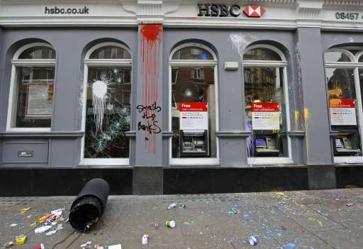 A branch of HSBC bank is pictured after it was attacked by activists during a Trade Union Congress (TUC) march in London on March 26, 2011. Hundreds of thousands of people from all over the United Kingdom took part in the march to protest against government cuts. AFP PHOTO/Carl de Souza