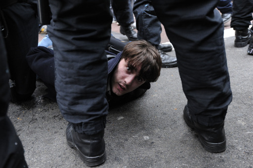 A protester is arrested during a mass demonstration against government financial cuts in central London on March 26, 2011. Hundreds of thousands of demonstrators marched in London today in protest at the government's austerity measures, amid a heavy police presence that failed to stop outbreaks of violence.AFP PHOTO / CARL COURT
