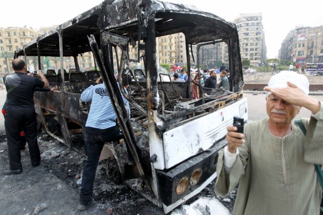 Egyptians walk past a burnt armed forces truck at Tahrir Square in Cairo on April 9, 2011 following clashes in which two people were killed and at least 18 wounded when Egyptian military police stormed the capital's iconic square to disperse protesters demanding the departure of Egypt's interim military rulers, medical sources told AFP. AFP PHOTO / KHALED DESOUKI , Egyptians walk past a burnt armed forces truck at Tahrir Square in Cairo on April 9, 2011 following clashes in which two people were killed and at least 18 wounded when Egyptian military police stormed the capital's iconic square to disperse protesters demanding the departure of Egypt's interim military rulers, medical sources told AFP. AFP PHOTO / KHALED DESOUKI , Egyptians walk past a burnt truck at Tahrir Square in Cairo on April 9, 2011 following clashes in which two people were killed and at least 18 wounded when Egyptian military police stormed the capital's iconic square to disperse protesters demanding the departure of Egypt's interim military rulers, medical sources told AFP. AFP PHOTO / KHALED DESOUKI , An Egyptian protester marks a bullet hole on a sidewalk fence at Tahrir Square in Cairo on April 9, 2011 following clashes in which two people were killed and at least 18 wounded when Egyptian military police stormed the capital's iconic square to disperse protesters demanding the departure of Egypt's interim military rulers, medical sources told AFP. AFP PHOTO / KHALED DESOUKI , Egyptian protesters show a bullet hole on a sidewalk fence at Tahrir Square in Cairo on April 9, 2011 following clashes in which two people were killed and at least 18 wounded when Egyptian military police stormed the capital's iconic square to disperse protesters demanding the departure of Egypt's interim military rulers, medical sources told AFP. AFP PHOTO / KHALED DESOUKI , A man takes a picture of Egyptian protesters sitting next to blood stains at Tahrir Square in Cairo on April 9, 2011 following clashes in which two people were killed and at least 18 wounded when Egyptian military police stormed the capital's iconic square to disperse protesters demanding the departure of Egypt's interim military rulers, medical sources told AFP. AFP PHOTO / KHALED DESOUKI , Egyptian youth gather around a destroyed truck at Tahrir Square in Cairo on April 9, 2011 following clashes in which two people were killed and at least 18 wounded when Egyptian military police stormed the capital's iconic square to disperse protesters demanding the departure of Egypt's interim military rulers, medical sources told AFP. AFP PHOTO / KHALED DESOUKI , An Egyptian protester shows spent bullets and a blood-stained sheet at Tahrir Square in Cairo on April 9, 2011 following clashes in which two people were killed and at least 18 wounded when Egyptian military police stormed the capital's iconic square to disperse protesters demanding the departure of Egypt's interim military rulers, medical sources told AFP. AFP PHOTO / KHALED DESOUKI , An Egyptian protester shows spent bullets and a blood-stained sheet at Tahrir Square in Cairo on April 9, 2011 following clashes in which two people were killed and at least 18 wounded when Egyptian military police stormed the capital's iconic square to disperse protesters demanding the departure of Egypt's interim military rulers, medical sources told AFP. AFP PHOTO / KHALED DESOUKI , Egyptians inspect a burnt armed forces bus at Tahrir Square in Cairo on April 9, 2011 as two people were killed and at least 18 wounded when Egyptian military police stormed the capital's iconic square to disperse protesters demanding the departure of Egypt's interim military rulers, medical sources told AFP. AFP PHOTO / KHALED DESOUKI