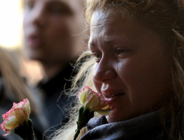 A woman mourns at the  entrance to the metro station hit by a blast in downtown Minsk, on April 12, 2011.  Several people have been arrested for the April 11 bombing on the Minsk metro that killed 12 and wounded 150, the first major apparent act of terror in its post-Soviet history. AFP PHOTO / VIKTOR DRACHEV , A woman places a candle near the entrance to the metro station hit by a blast in downtown Minsk, on April 12, 2011.  Several people have been arrested for the April 11 bombing on the Minsk metro that killed 12 and wounded 150, the first major apparent act of terror in its post-Soviet history.  AFP PHOTO / VIKTOR DRACHEV , A woman cries near an entrance to the metro station hit by a blast in downtown Minsk, on April 12, 2011.  Several people have been arrested for the April 11 bombing on the Minsk metro that killed 12 and wounded 150, the first major apparent act of terror in its post-Soviet history. AFP PHOTO / VIKTOR DRACHEV