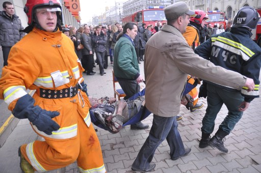 A rescue team carries a man injured in a blast at a metro station in downtown Minsk, on April 11, 2011. At least 11 people were killed and a 100 wounded in a blast at a metro station near Belarus President Alexander Lukashenko's office in Minsk, Belarussian television said. AFP PHOTO / SERGEY BALAY