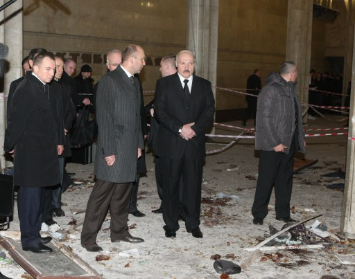 A picture taken on April 11, 2011, shows Belarussian President Alexander Lukashenko (2nd R) visiting the metro station Oktyabrskaya in Minsk shortly after the blast. Belarus sought to identify the perpetrators behind the bombing on the Minsk metro that killed 12 and wounded 150, the first major apparent act of terror in its post-Soviet history. The explosion at a busy metro station in the heart of the Belarussian capital near the headquarters of President Alexander Lukashenko stunned a city which has never seen attacks like those suffered in neighbouring Russia.  AFP PHOTO / POOL / ANDREI STASEVICH
