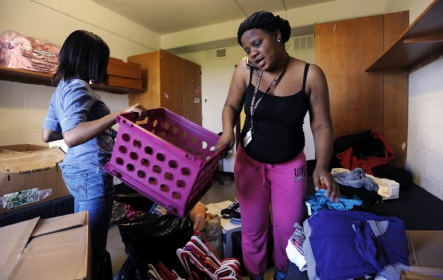 RALEIGH, NC - APRIL 17: Shaw University freshmen Artricia Brittle (R), 18 of Washington, D.C., coordinates a way home as she packs up her belongings in her dorm room with along with her roommate Denaysha Bowen, 18 of Maryland, on April 17, 2011 in Raleigh, North Carolina. The historically black university located in downtown Raleigh canceled the rest of the semester due to extensive damage from tornadoes the afternoon before. Multiple tornados tore through North Carolina on April 16, killing at least 43 people.   Sara D. Davis/Getty Images/AFP== FOR NEWSPAPERS, INTERNET, TELCOS & TELEVISION USE ONLY ==