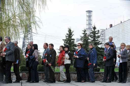 In-plant personnel and visitors wait in line to lay flowers during a commemoration ceremony for 25th anniversary the Chernobyl Nuclear disaster in front of Chernobyl nuclear power plant, about 180 km. north from Kiev, on April 26, 2011. The world on Tuesday marks a quarter century since the world's worst nuclear disaster at Chernobyl in Ukraine. AFP PHOTO / GENYA SAVILOV