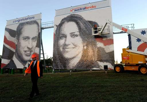 Workers put the finishing touches onto a pair of coloured brick murals featuring the faces of Britain's Prince William and Catherine Middleton near Sydney on April 28, 2011. The two 100 metre square brick murals, which contain 8,300 bricks and 7,500 half bricks of different shades, will stay in place for three months to celebrate the royal wedding in London.  AFP PHOTO / Torsten BLACKWOOD