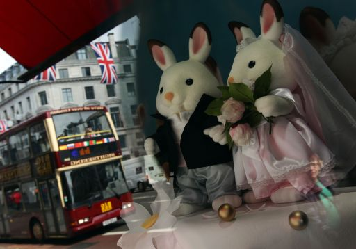 Cuddly toys dressed in wedding outfits are pictured in the window of Hamleys toy store in London, on April 28, 2011. The store featured several different kinds of toys with a wedding theme ahead of Britain's Prince William marriage to his fiancee Kate Middleton at Westminster Abbey in London on April 29, 2011. AFP PHOTO / Adrian Dennis