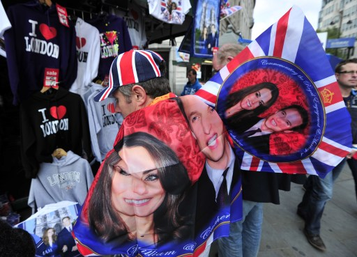 A street vendor sells royal wedding souvenirs in Trafalgar Square in central London, on April 28, 2011. Britain's Prince William is to marry his fiancee Kate Middleton at Westminster Abbey in London, on April 29, 2011. AFP PHOTO / GLYN KIRK