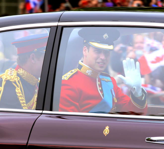 LONDON, ENGLAND - APRIL 29:  Prince William of Wales (R) waves to the crowds with his brother Prince Harry of Wales as they arrive to attend the Royal Wedding of Prince William to Catherine Middleton at Westminster Abbey on April 29, 2011 in London, England. The marriage of the second in line to the British throne is to be led by the Archbishop of Canterbury and will be attended by 1900 guests, including foreign Royal family members and heads of state. Thousands of well-wishers from around the world have also flocked to London to witness the spectacle and pageantry of the Royal Wedding.  (Photo by Julian Finney/Getty Images)