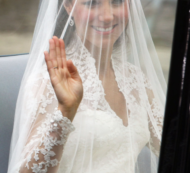 LONDON, ENGLAND - APRIL 29:  Catherine Middleton waves as she arrives for the Royal Wedding of Prince William to Catherine Middleton at Westminster Abbey on April 29, 2011 in London, England. The marriage of the second in line to the British throne is to be led by the Archbishop of Canterbury and will be attended by 1900 guests, including foreign Royal family members and heads of state. Thousands of well-wishers from around the world have also flocked to London to witness the spectacle and pageantry of the Royal Wedding.  (Photo by Dan Kitwood/Getty Images)