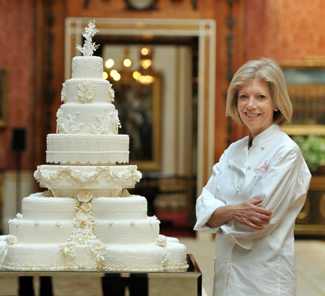 LONDON, ENGLAND - APRIL 29:  Fiona Cairns stands next to the Royal Wedding cake that she and her team at Fiona Cairns Ltd of Leicestershire made for Prince William and Catherine Middleton in the Picture Gallery of Buckingham Palace on April 29, 2011 in central London, England. The marriage of Prince William, the second in line to the British throne, to Catherine Middleton is being held in London today. The Archbishop of Canterbury conducted the service which was attended by 1900 guests, including foreign Royal family members and heads of state. Thousands of well-wishers from around the world have also flocked to London to witness the spectacle and pageantry of the Royal Wedding and street parties are being held throughout the UK.  (John Stillwell-WPA Pool/Getty Images)