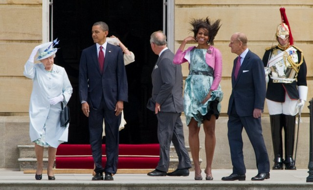 US President Barack Obama (2ndL) and First Lady Michelle Obama (R) leave with Britain's Queen Elizabeth II (L) and Prince Philip, Duke of Edinburgh, after a guard of honour at the Buckingham Palace in London on May 24, 2011. Obama began an official two-day state visit to Britain after charming a star-struck Ireland on the first leg of a major European tour. Obama's visit, which was brought forward due to a volcanic ash cloud drifting towards Britain, promises to be a more ceremonial affair than his jocular Irish trip with the queen rolling out the red carpet for the US leader.   AFP PHOTO/ JEWEL SAMAD