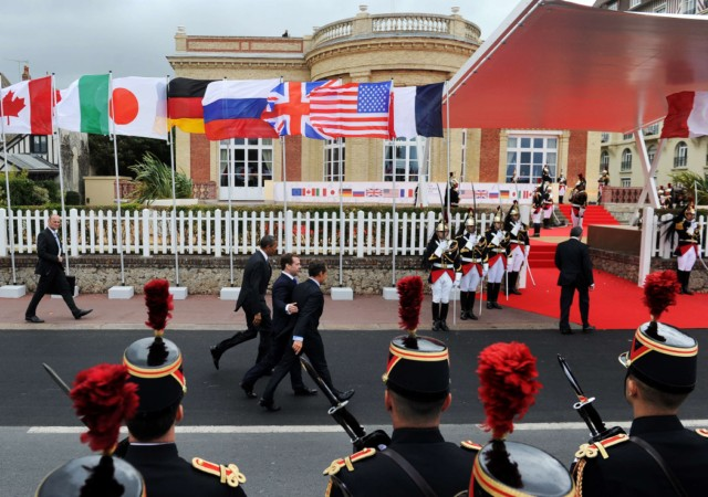 French President Nicolas Sarkozy's wife, Carla Bruni-Sarkozy, arrives to welcome the wives of the Heads of Delegation participating in the G8 Summit at the Villa Strassburger during the G8 summit in Deauville, western France, on May 26, 2011. The wives of the G8 leaders meet on the sidelines of the formal summit to discuss issues such as the fight against illiteracy.   AFP PHOTO / POOL / Virginia Mayo , US President Barack Obama (2nd-L) and Russian President Dmitry Medvedev (L) wave to a crowd as French President Nicolas Sarkozy (R) smiles outside the Centre International de Deauville as they arrive to join G8 summit in Deauville on May 26, 2011. G8 chiefs met to call for an end to the violent repression of revolts in Syria and Libya on Thursday and expressed confidence that partner Japan will recover fully from nuclear disaster. AFP Photo/Jewel Samad , US President Barack Obama (L) and Russian President Dmitry Medvedev (C) and French President Nicolas Sarkozy wave to the crowd at the Centre International de Deauville as they arrive to join G8 summit in Deauville on May 26, 2011. G8 chiefs met to call for an end to the violent repression of revolts in Syria and Libya and expressed confidence that partner Japan will recover fully from nuclear disaster. AFP Photo/Jewel Samad , US President Barack Obama (L) and Russian President Dmitry Medvedev (C) are greeted by French President Nicolas Sarkozy at the Centre International de Deauville as they arrive to join G8 summit in Deauville on May 26, 2011. G8 chiefs met to call for an end to the violent repression of revolts in Syria and Libya on Thursday and expressed confidence that partner Japan will recover fully from nuclear disaster. AFP Photo/Jewel Samad , US President Barack Obama (c-L) and Russian President Dmitry Medvedev (C) are greeted by French President Nicolas Sarkozy at the Centre International de Deauville as they arrive to join G8 summit in Deauville on May 26, 2011. G8 chiefs met to call for an end to the violent repression of revolts in Syria and Libya on Thursday and expressed confidence that partner Japan will recover fully from nuclear disaster. AFP Photo/Jewel Samad