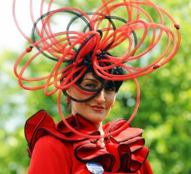 A Race-goer wearing a flamboyant hat poses for the media on Ladies Day at the annual Royal Ascot horse racing event near Windsor, Berkshire on June 16, 2011. The five-day meeting is one of the highlights of the global horse racing calendar. AFP PHOTO/Carl de Souza , A race-goer wearing a flamboyant hat takes a picture on Ladies Day at the annual Royal Ascot horse racing event near Windsor, Berkshire on June 16, 2011. The five-day meeting is one of the highlights of the global horse racing calendar. AFP PHOTO/Carl de Souza , A Race-goer wearing flamboyant hats poses for the media on Ladies Day at the annual Royal Ascot horse racing event near Windsor, Berkshire on June 16, 2011. The five-day meeting is one of the highlights of the global horse racing calendar. AFP PHOTO/Carl de Souza
