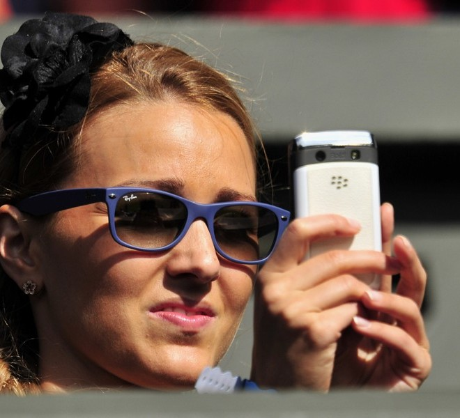 Jelena Ristic, partner of Serbian player Novak Djokovic, watches him play against French player Jeremy Chardy during a Men's Singles match at the 2011 Wimbledon Tennis Championships at the All England Tennis Club, in south-west London, on June 21, 2011. AFP PHOTO/GLYN KIRK/RESTRICTED TO EDITORIAL USE