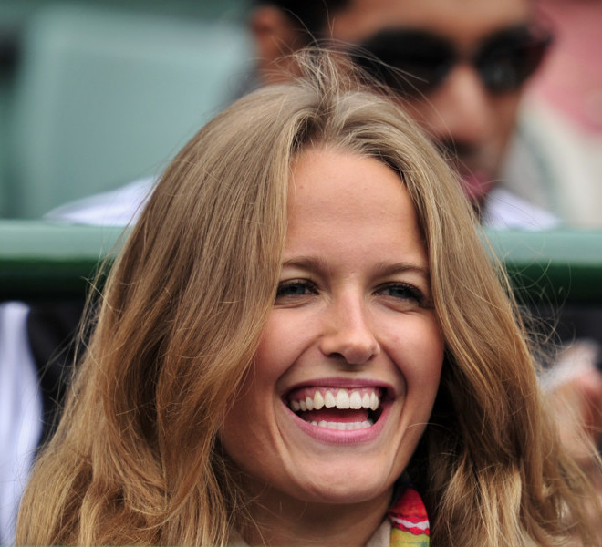 Kim Sears, partner of British player Andy Murray, watches him play against German player Tobias Kamke in a Men's Singles match at the 2011 Wimbledon Tennis Championships at the All England Tennis Club, in south-west London, on June 22, 2011. AFP PHOTO/GLYN KIRK/RESTRICTED TO EDITORIAL USE