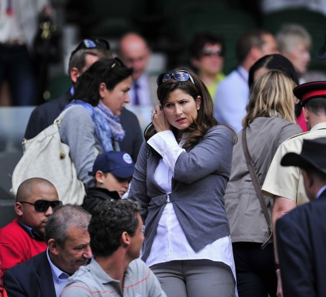 Mirka Vavrinec (C) partner of Swiss player Roger Federer, arrives on Centre Court to watch him play against Kazakh player Mikhail Kukushkin during a Men's Singles match at the 2011 Wimbledon Tennis Championships at the All England Tennis Club, in south-west London, on June 21, 2011. AFP PHOTO/GLYN KIRK/RESTRICTED TO EDITORIAL USE