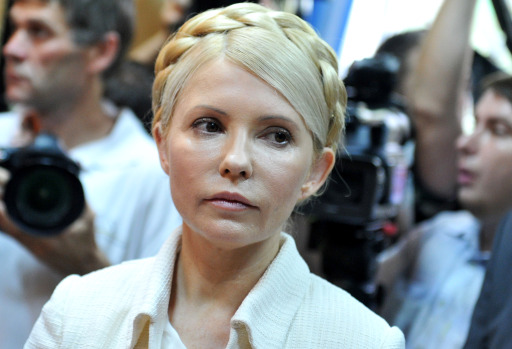 Ukraine's ex-prime minister Yulia Tymoshenko looks on at the beginning her court hearing in Kiev on June 24, 2011. Ukraine's ex-prime minister Yulia Tymoshenko went on trial for alleged abuse of power, in a case she has dismissed as revenge by President Viktor Yanukovych.  AFP PHOTO/ SERGEI SUPINSKY