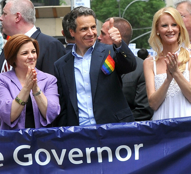 City Council Speaker Christine Quinn, Governor Andrew Cuomo and Cuomo's girlfriend Sandra Lee, left to right, walk in the annual Heritage of Pride March, one of the world's oldest and largest gay pride parades, Sunday June 26, 2011, in New York.