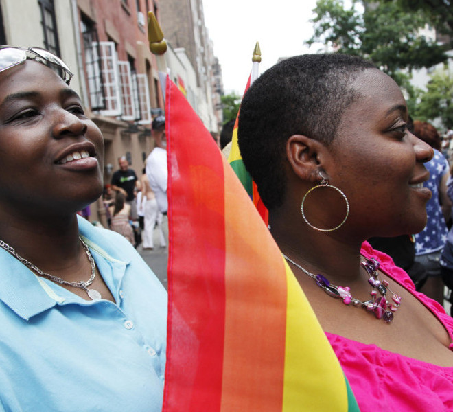 Yolanda Tolbert, left, and her partner Kisha Newsome wait for the annual Gay Pride parade to begin on Christopher Street in Greenwich Village, Sunday, June 26, 2011 in New York.