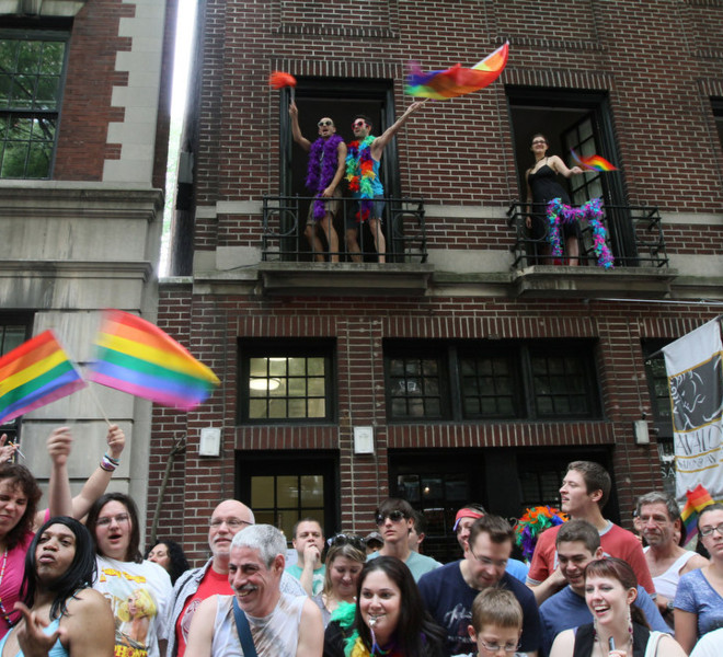Spectators react as the Gay Pride Parade passes them by Sunday, June 26, 2011 in New York.