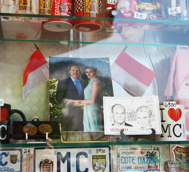 MONACO - JUNE 30:  A photograph of Prince Albert II of Monaco and Charlene Wittstock is displayed in a gift shop ahead of their Royal Wedding on June 30, 2011 in Monaco. The civil ceremony will take place in the Throne Room of the Prince's Palace of Monaco on July 1, followed by a religious ceremony to be conducted in the main courtyard of the Palace on July 2. With her marriage to the head of state of Principality of Monaco, Charlene Wittstock will become Princess consort of Monaco and gain the title, Princess Charlene of Monaco. Celebrations including concerts and firework displays are being held across several days, attended by a guest list of global celebrities and heads of state.  (Photo by Richard Heathcote/Getty Images)